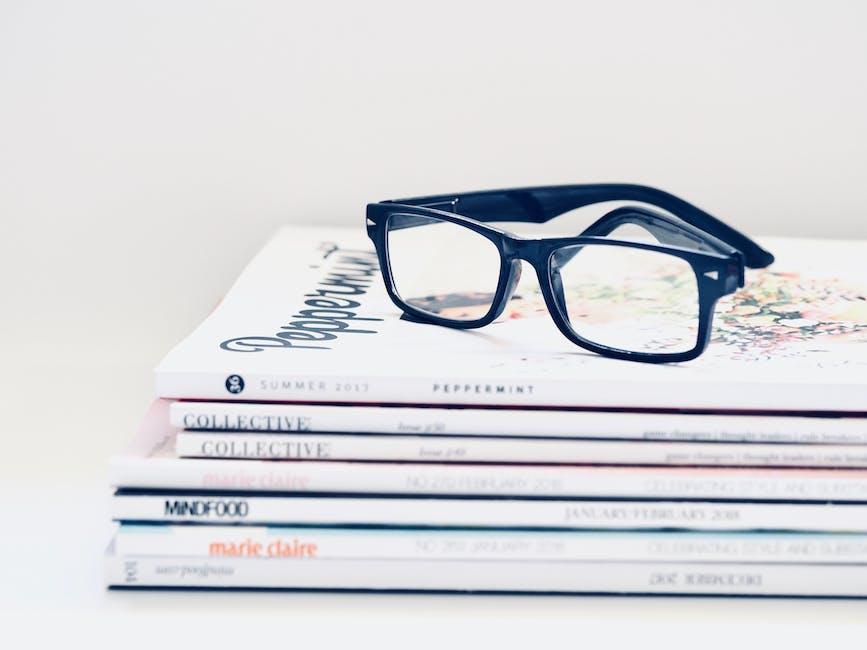 Black Framed Eyeglasses on Seven Collective Books