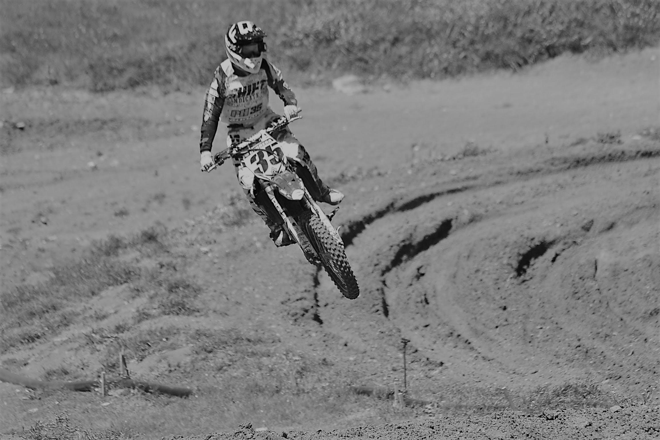 Free stock photo of biker, black and white, jump, motocross