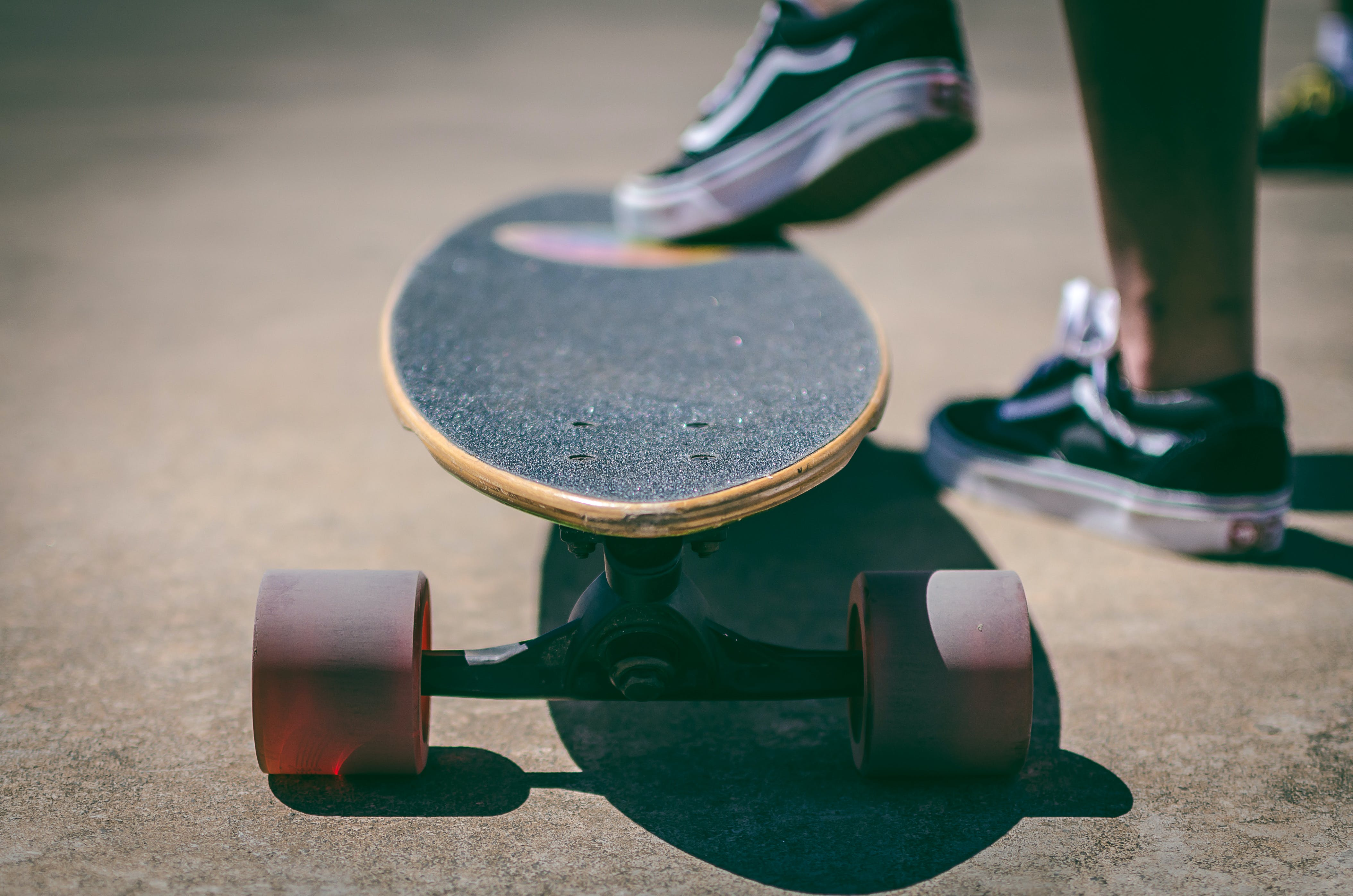 Shallow Focus Photography of Longboard