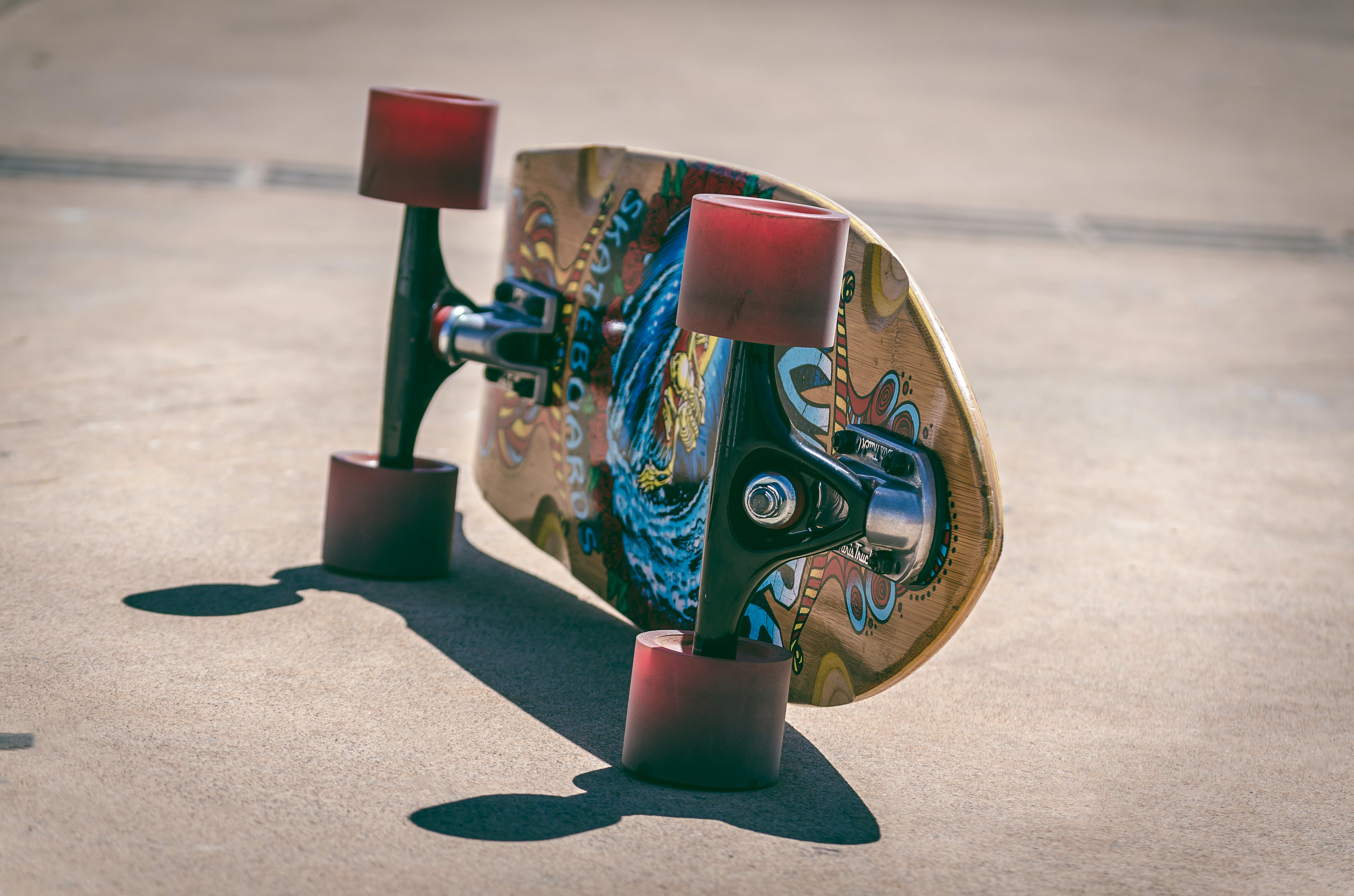 Shallow Focus Photography of Brown and Blue Skateboard