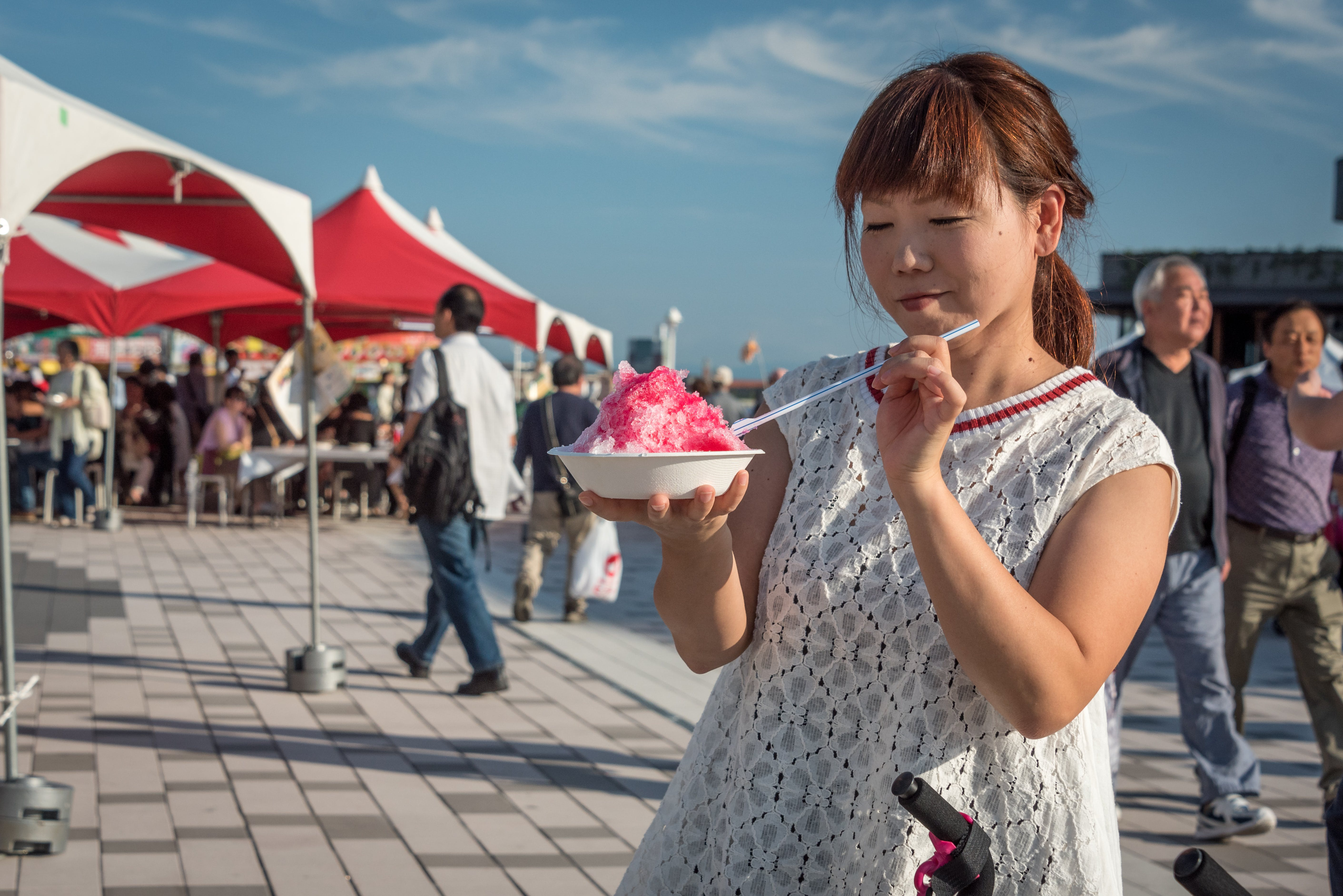 Photo of Woman Holding Bowl With Dessert