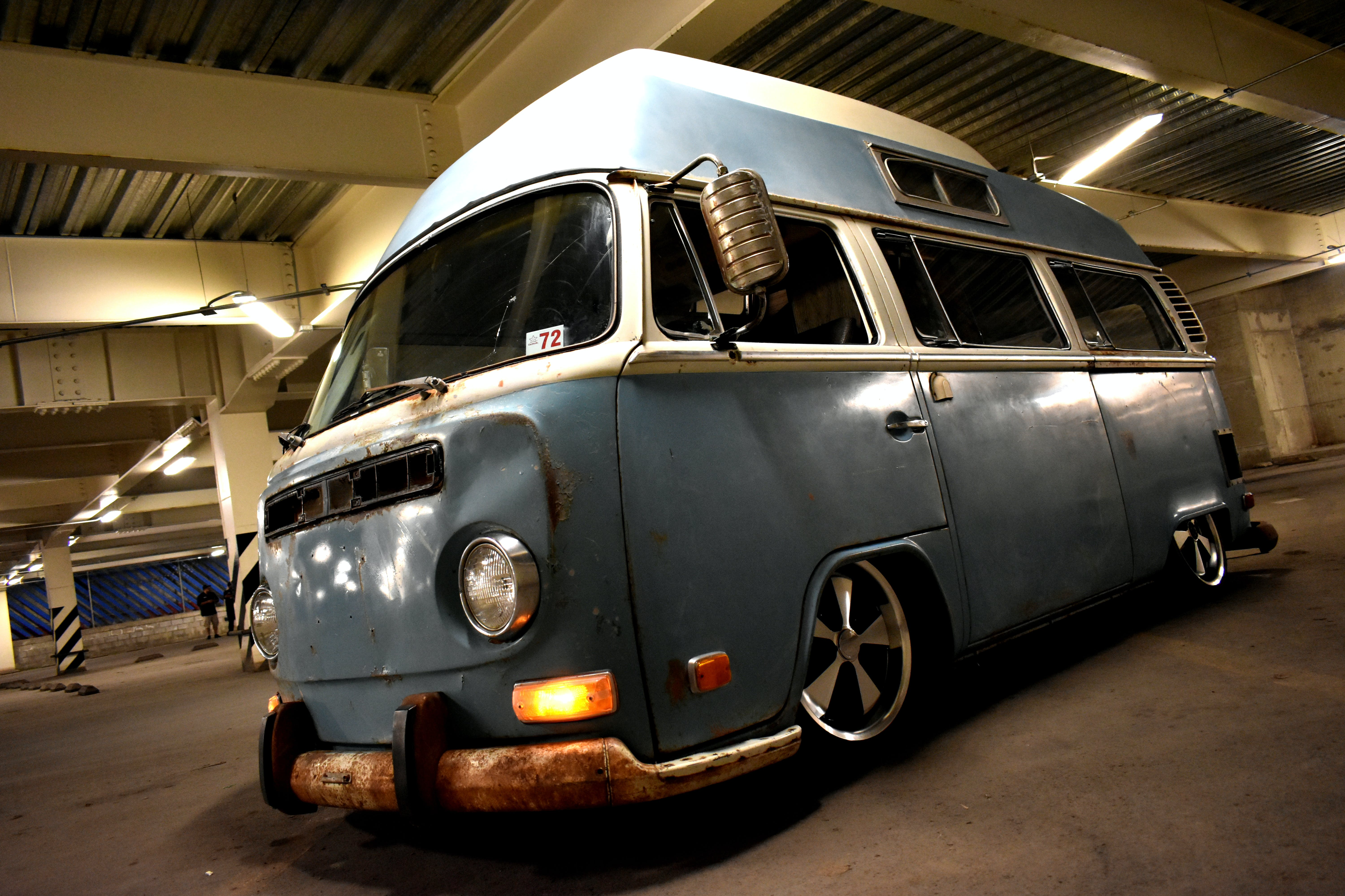 Classic Blue and White Van Parked Inside Building