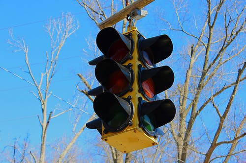 Free stock photo of blue sky, traffic light, trees