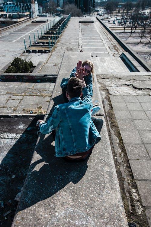 Sitting Man Wearing Blue Chambray Jacket