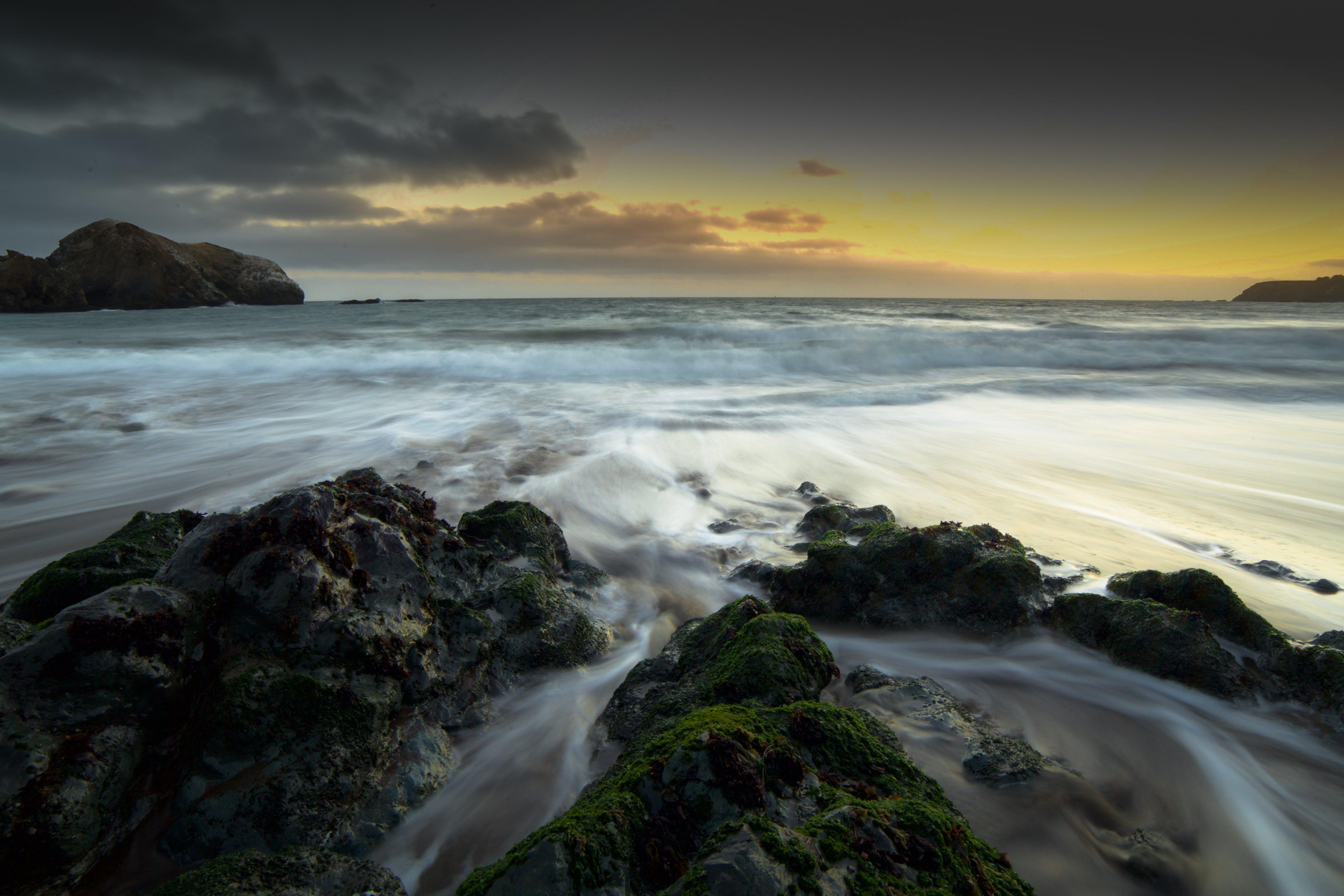 Rocks on Seashore during Golden Hour