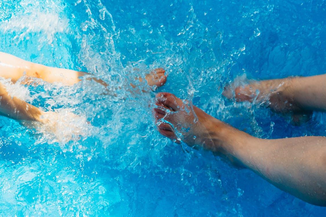 Free stock photo of feet, pool, splash