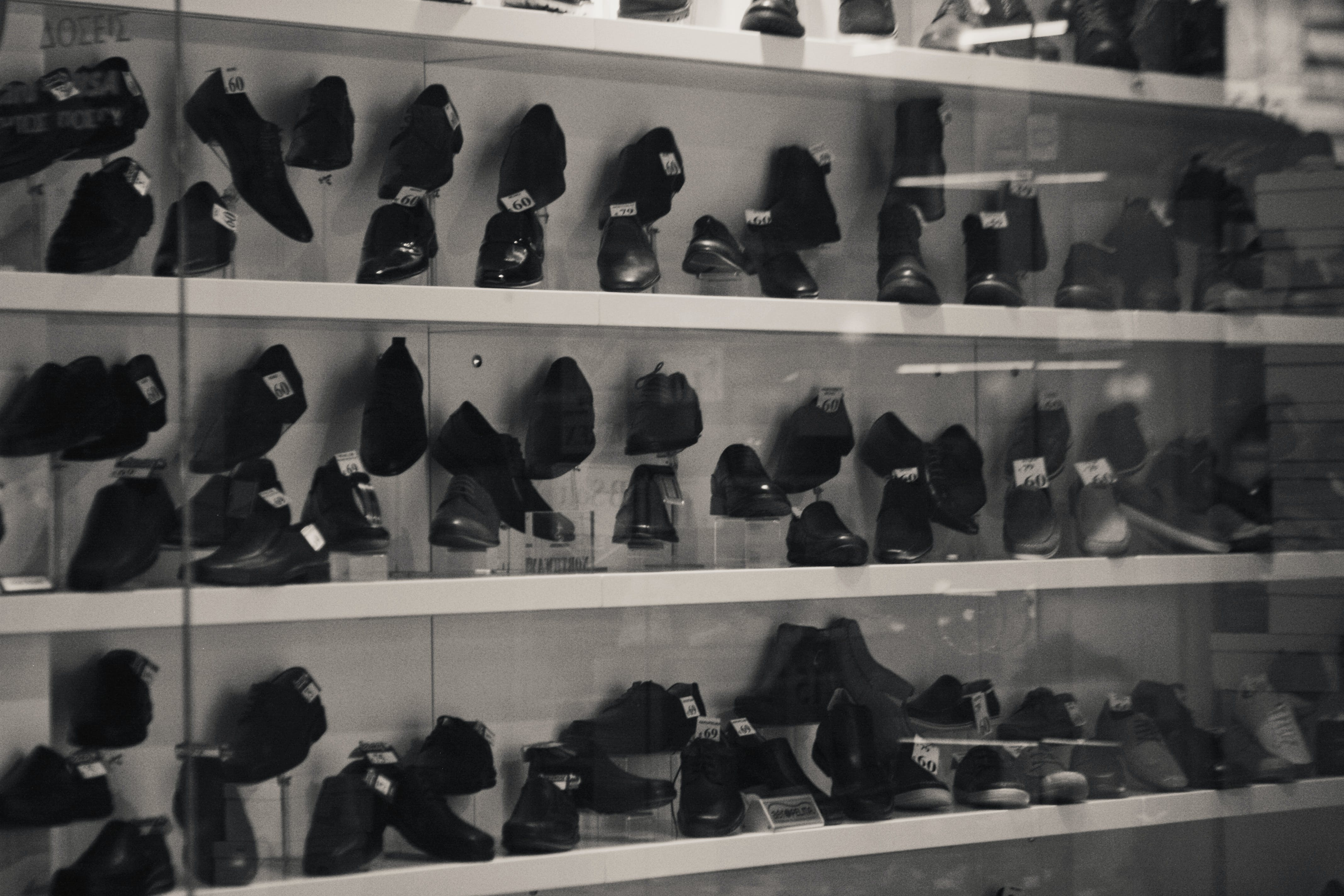 Grayscale Photography of Shoes on Racks