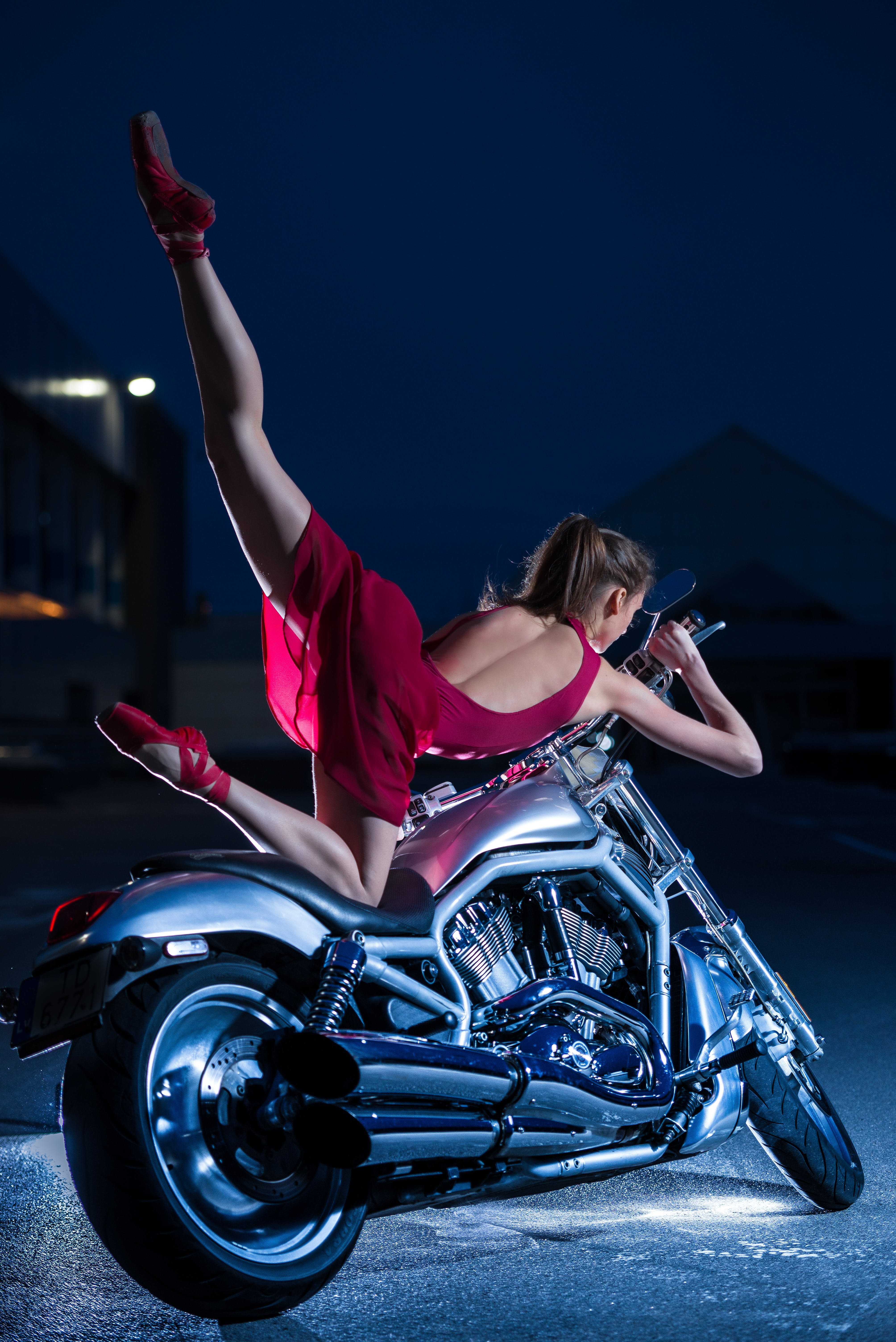 Woman Wearing Purple Dress Ride on Motorcycle during Nighttime
