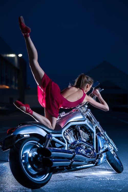 Woman Wearing Purple Dress Ride on Motorcycle during Nighttime