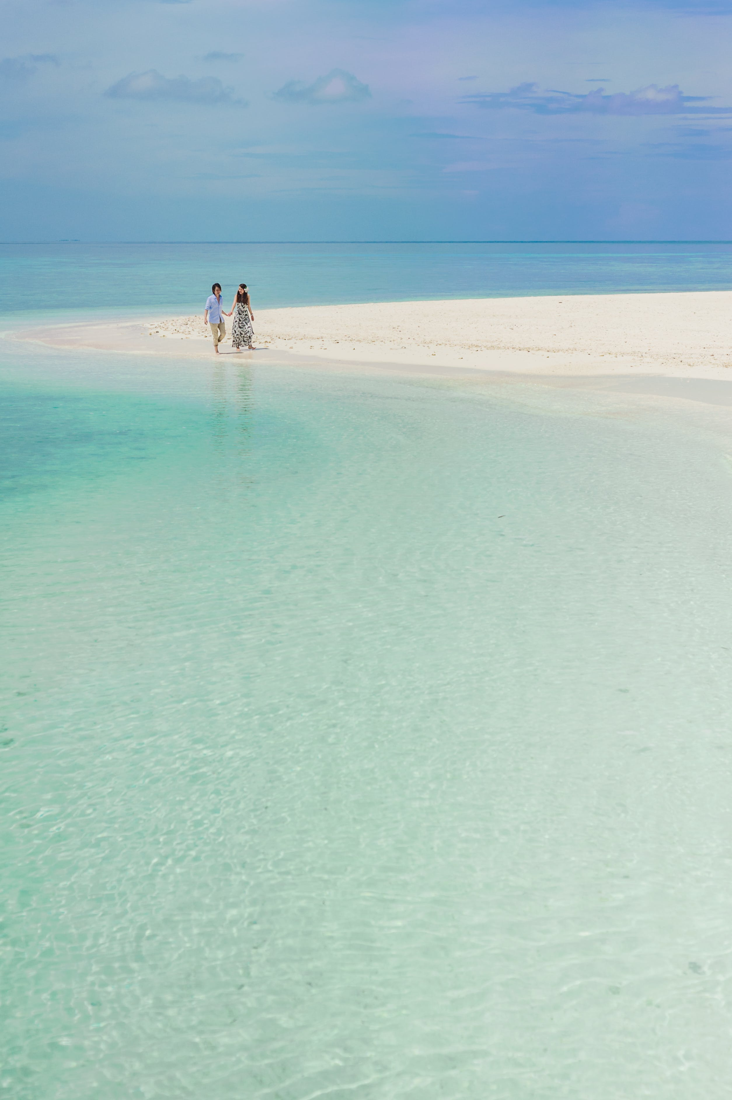 Two Person Walking on Beach