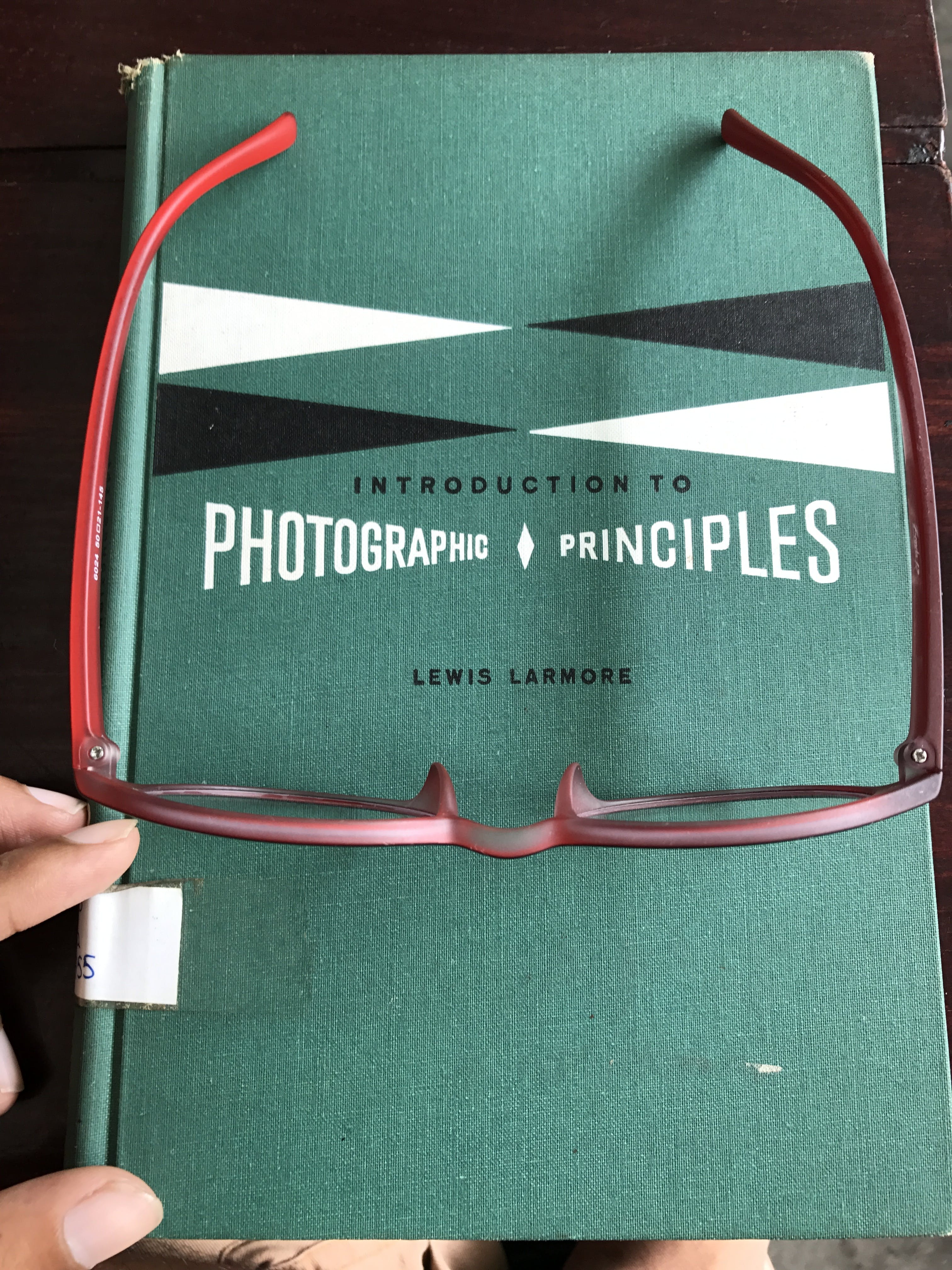 Eyeglasses With Red Frames on Blue Book