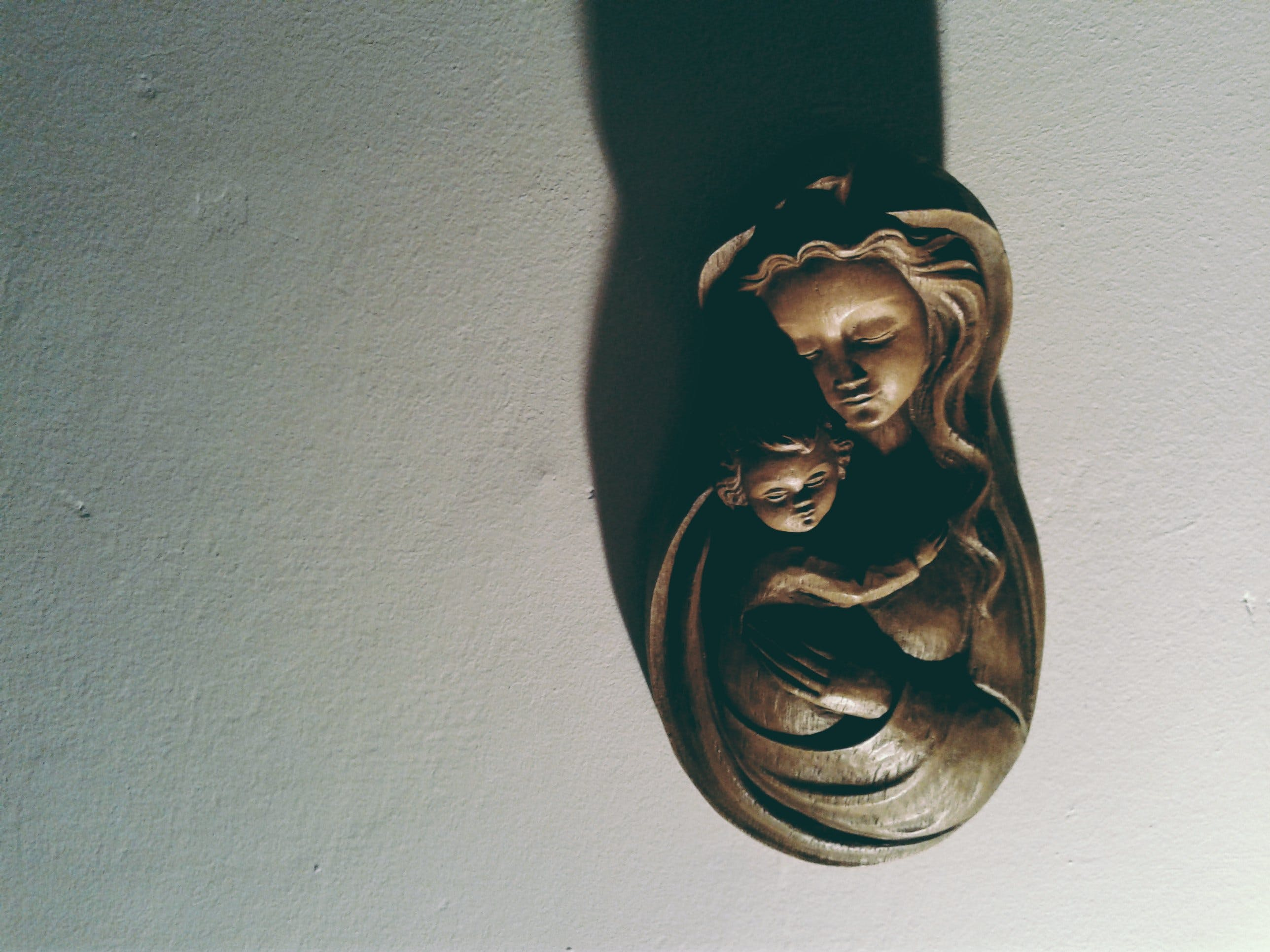 Woman Hugging Her Kid Bust Figurine
