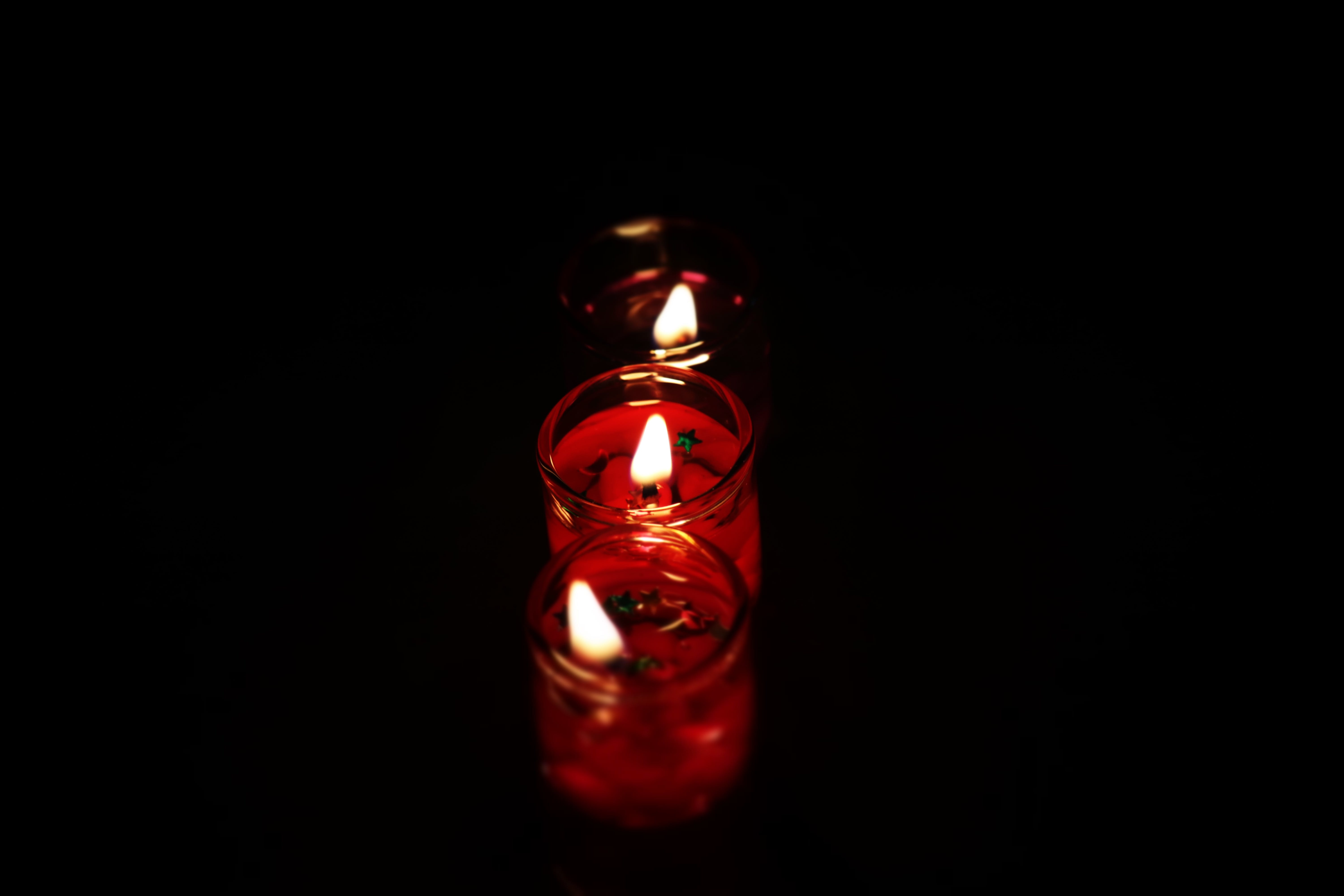 Photography Three Tealight Candles in Dark Place