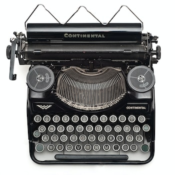 Black Continental Typewriter on White Surface