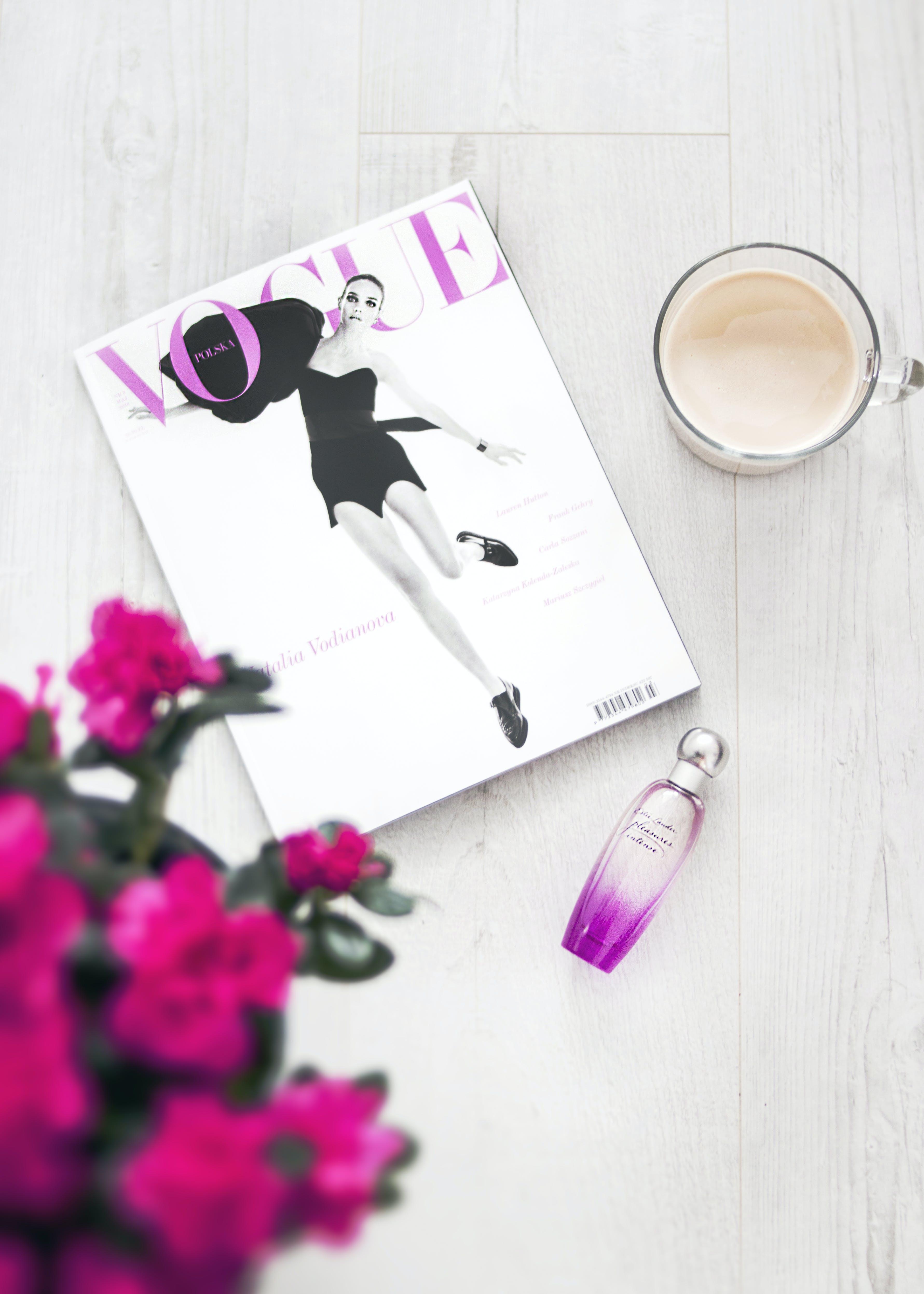 Vogue Magazine Beside Perfume Bottle