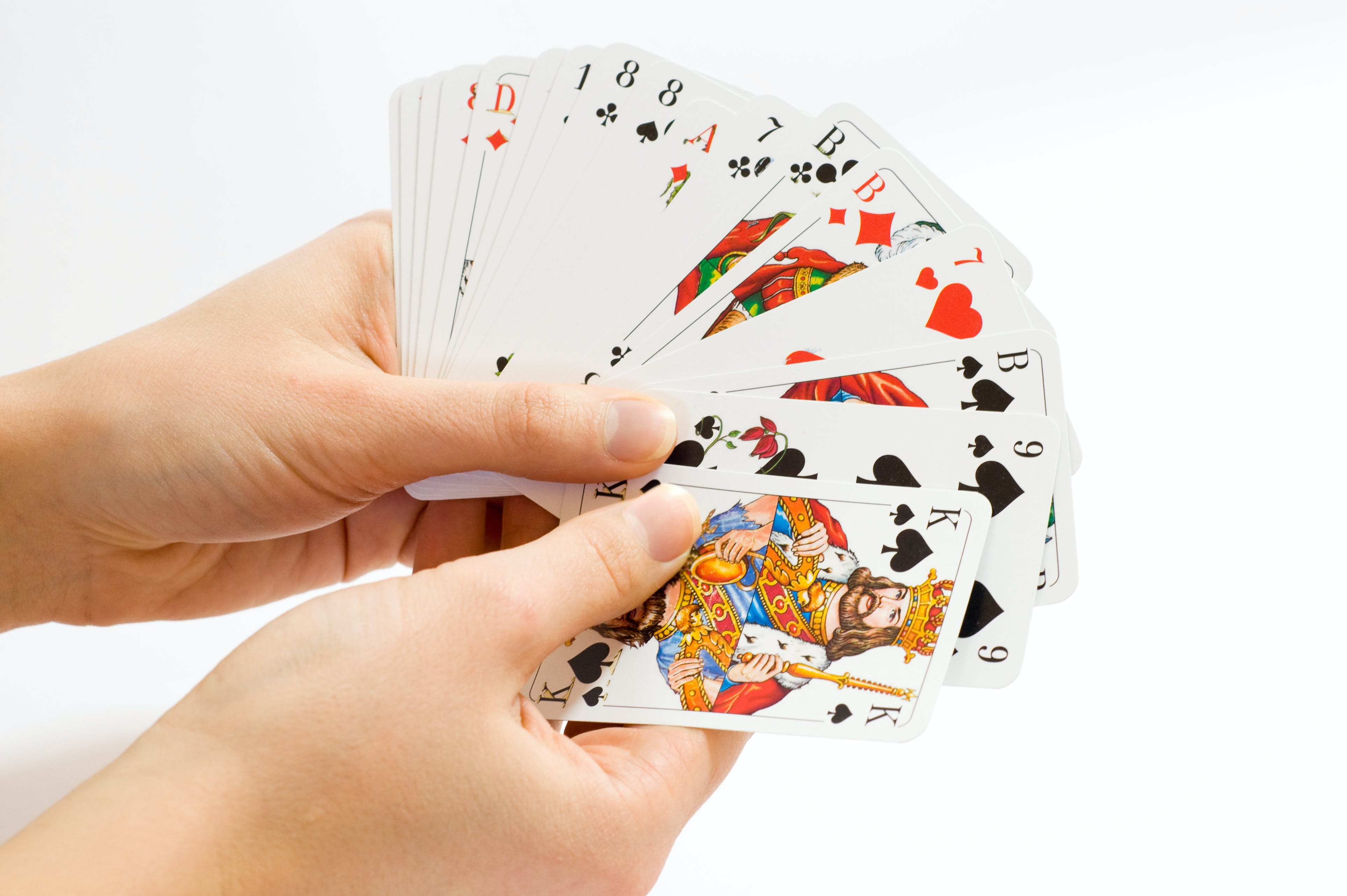 Person Holding Playing Cards