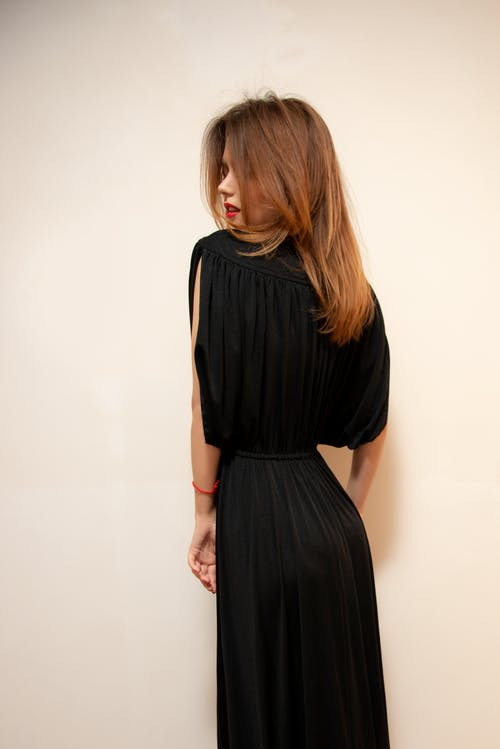 Photography of a Woman Wearing Black Dress