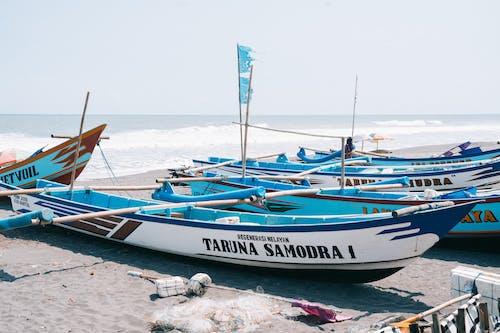 Photo of Boats Near Seashore