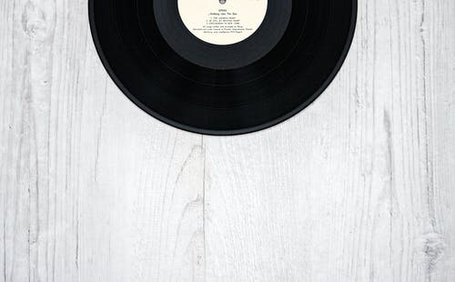 Black Vinyl Record on Wooden Surface