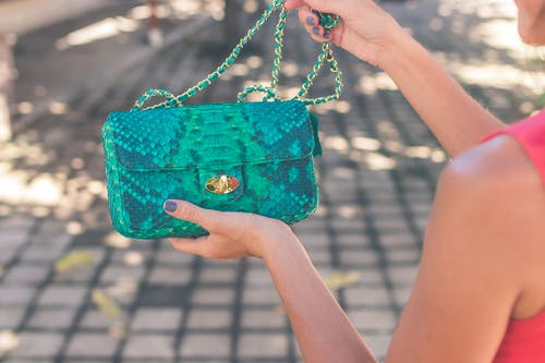 Photo of Woman Holding Blue Crossbody Bag