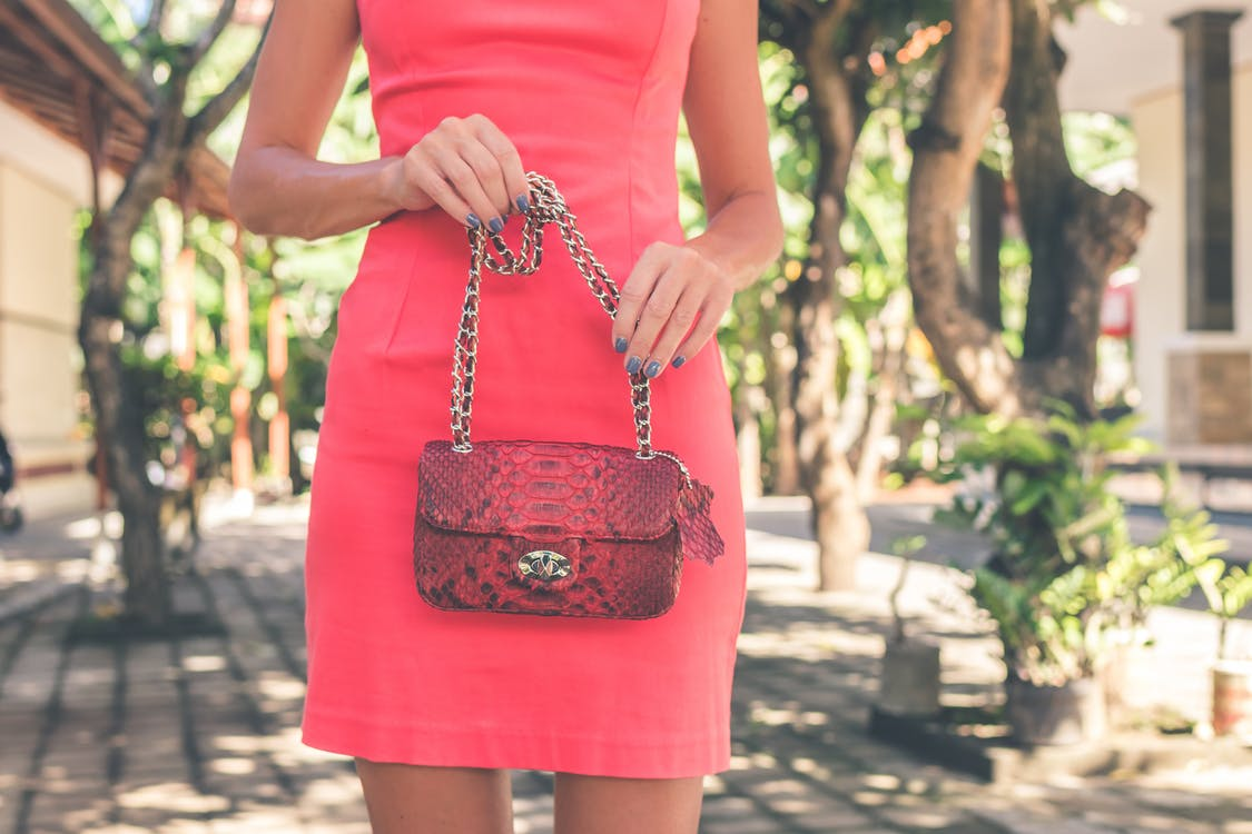 Photo of Woman Holding Red Bag