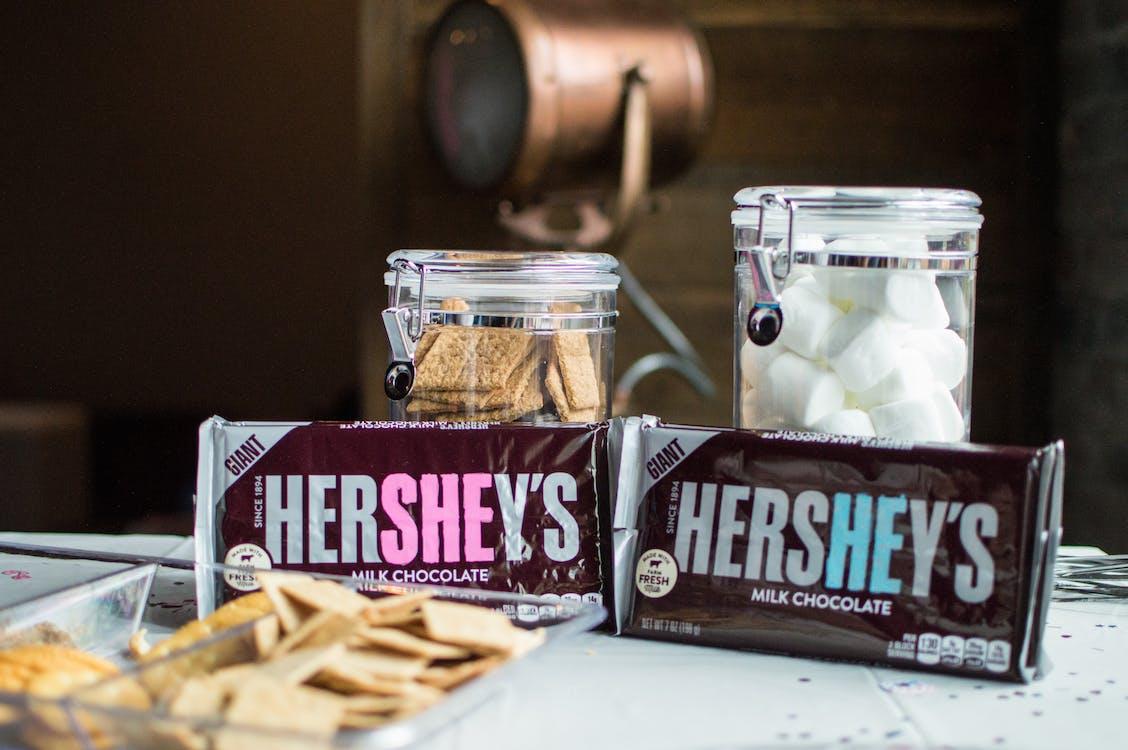 Close-up Photo of Hershey's Bars Near Jars
