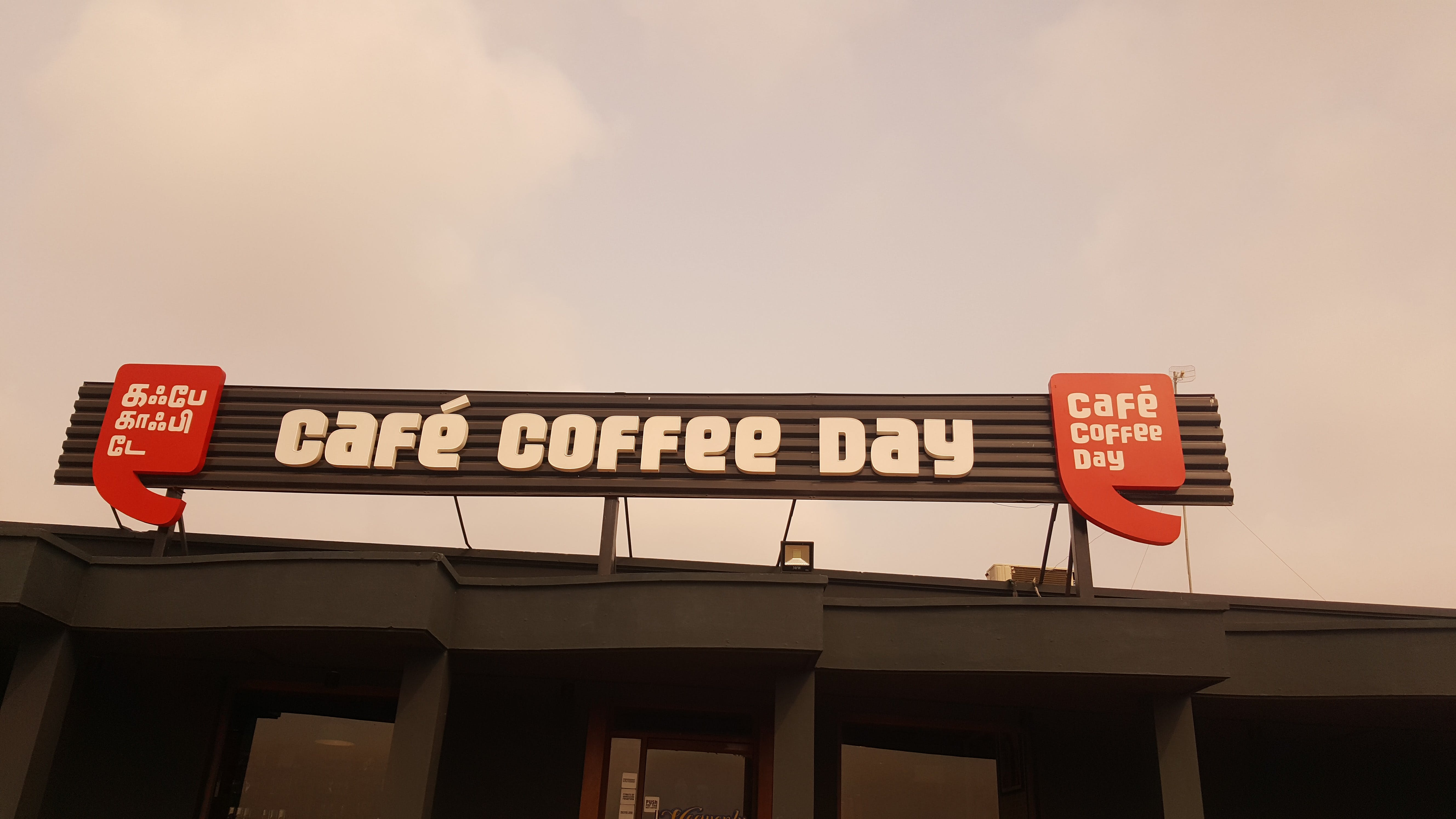 Photo of Cafe Coffee Day Sign