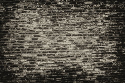 Grayscale Photo of Brickwall