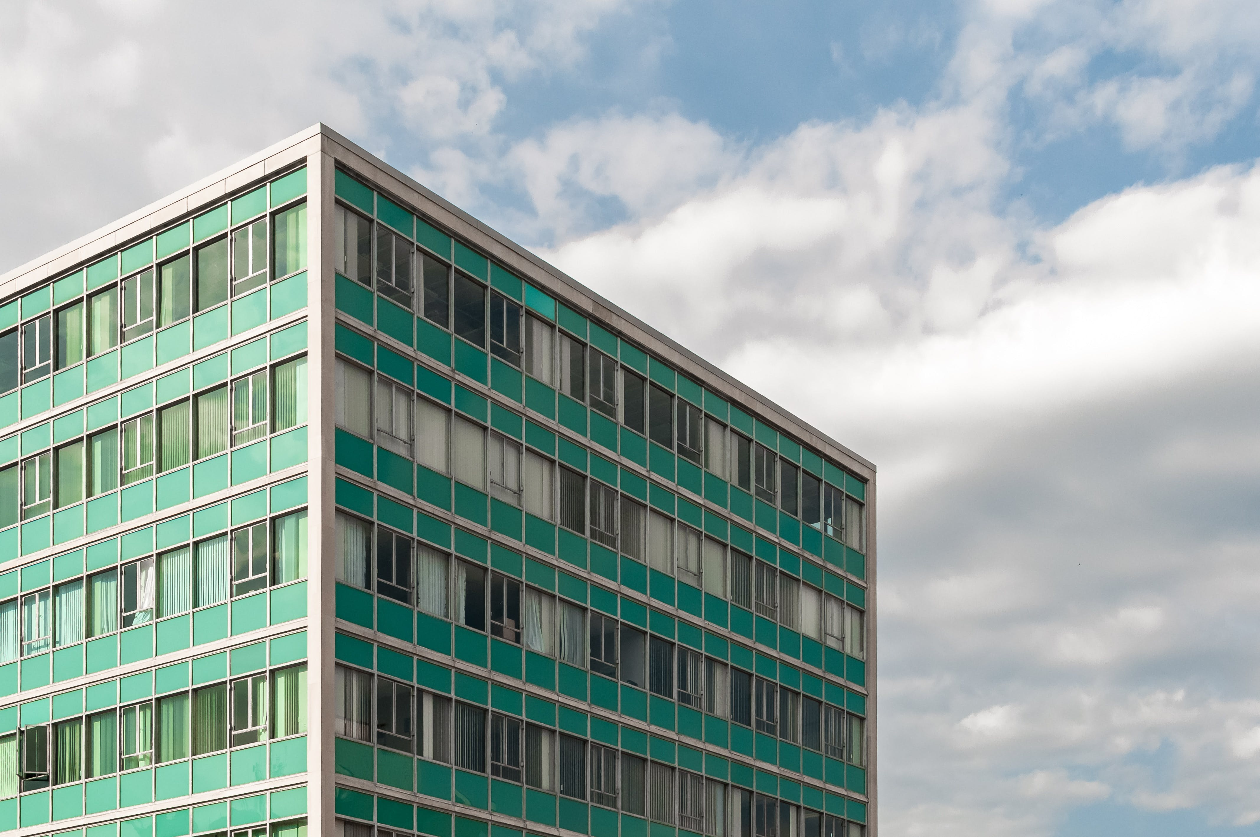 Photography of Building Under Cloudy Sky