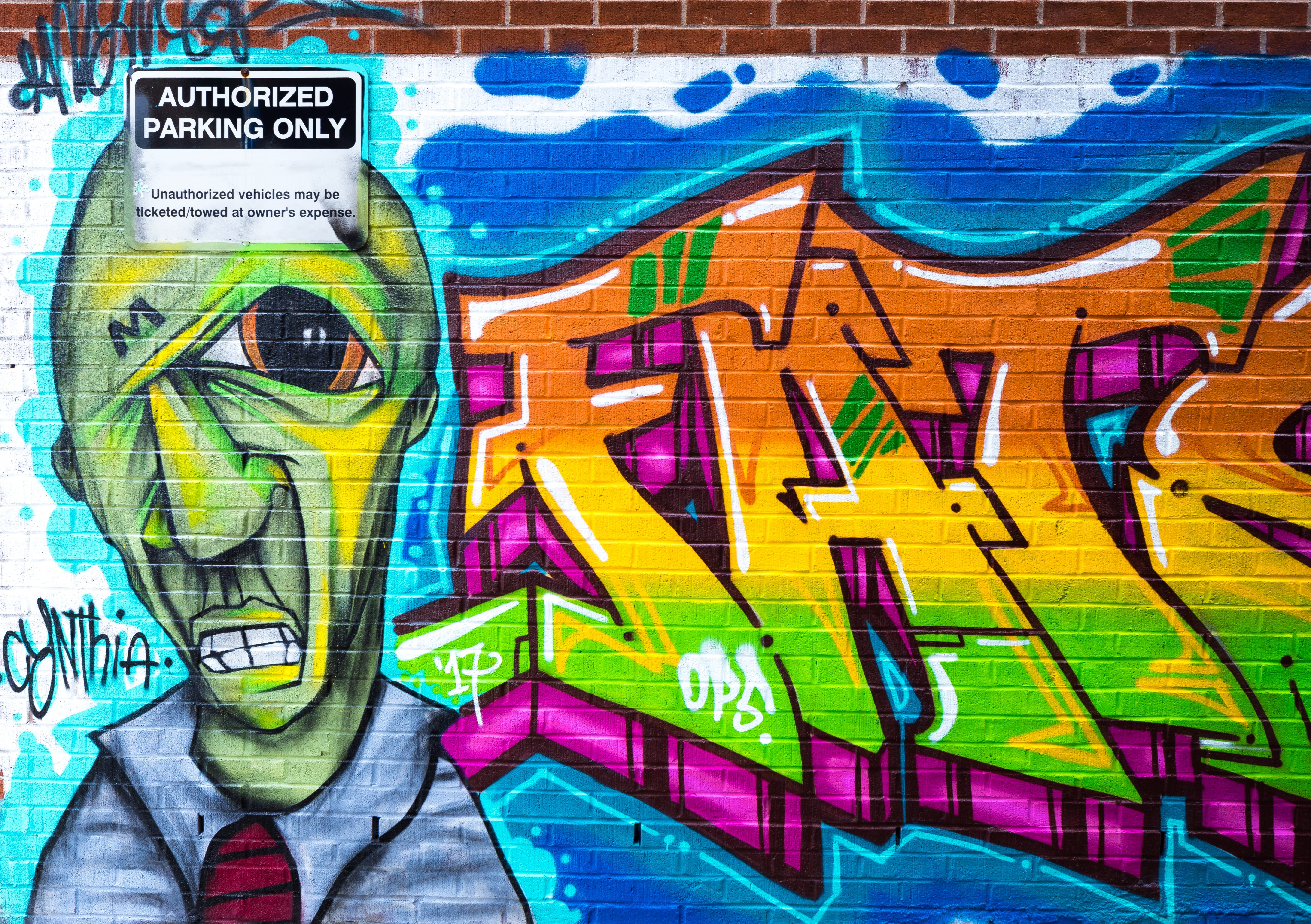 Photography of Brick Wall With Graffiti