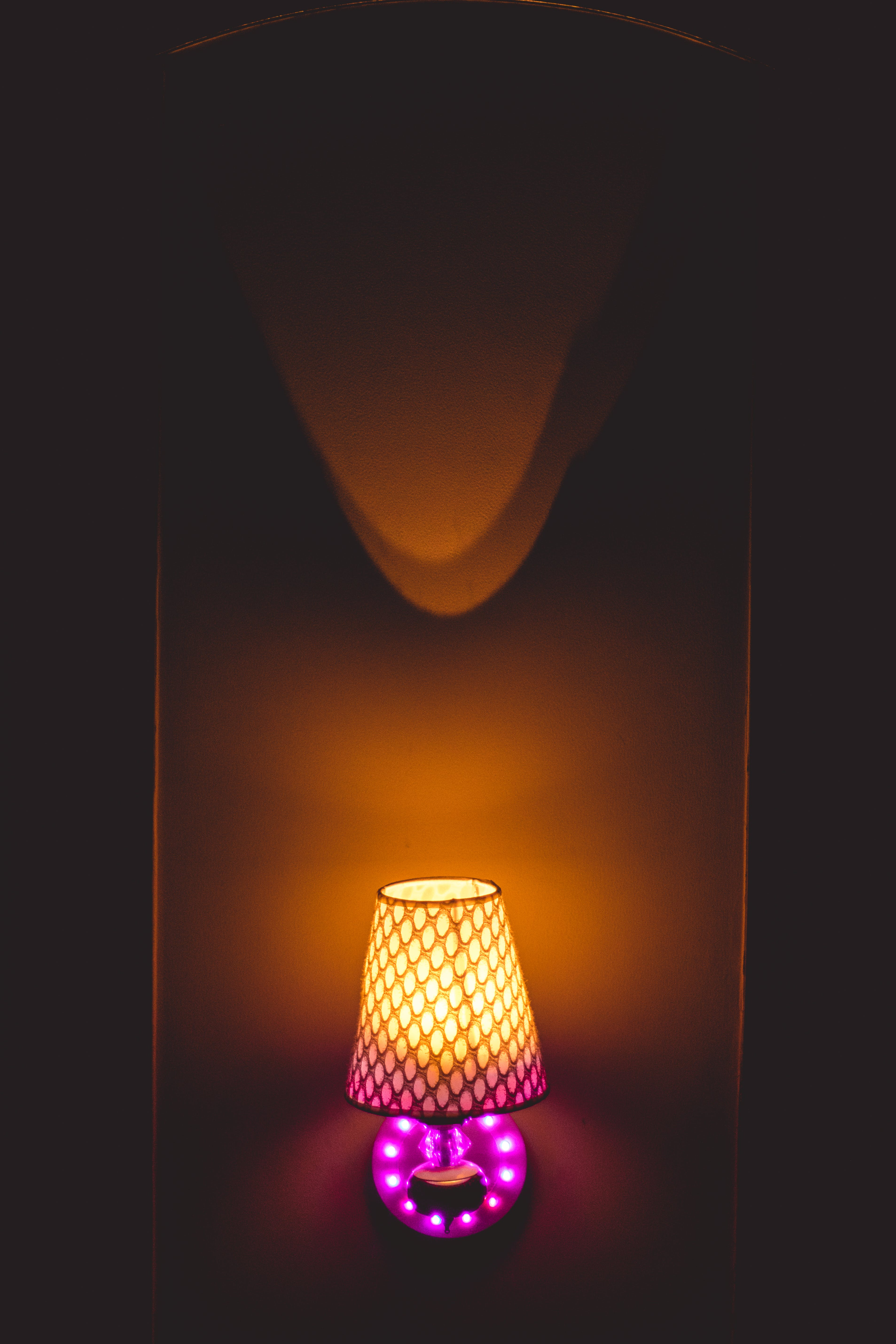 Photo of Yellow and Pink Table Lamp Turned on
