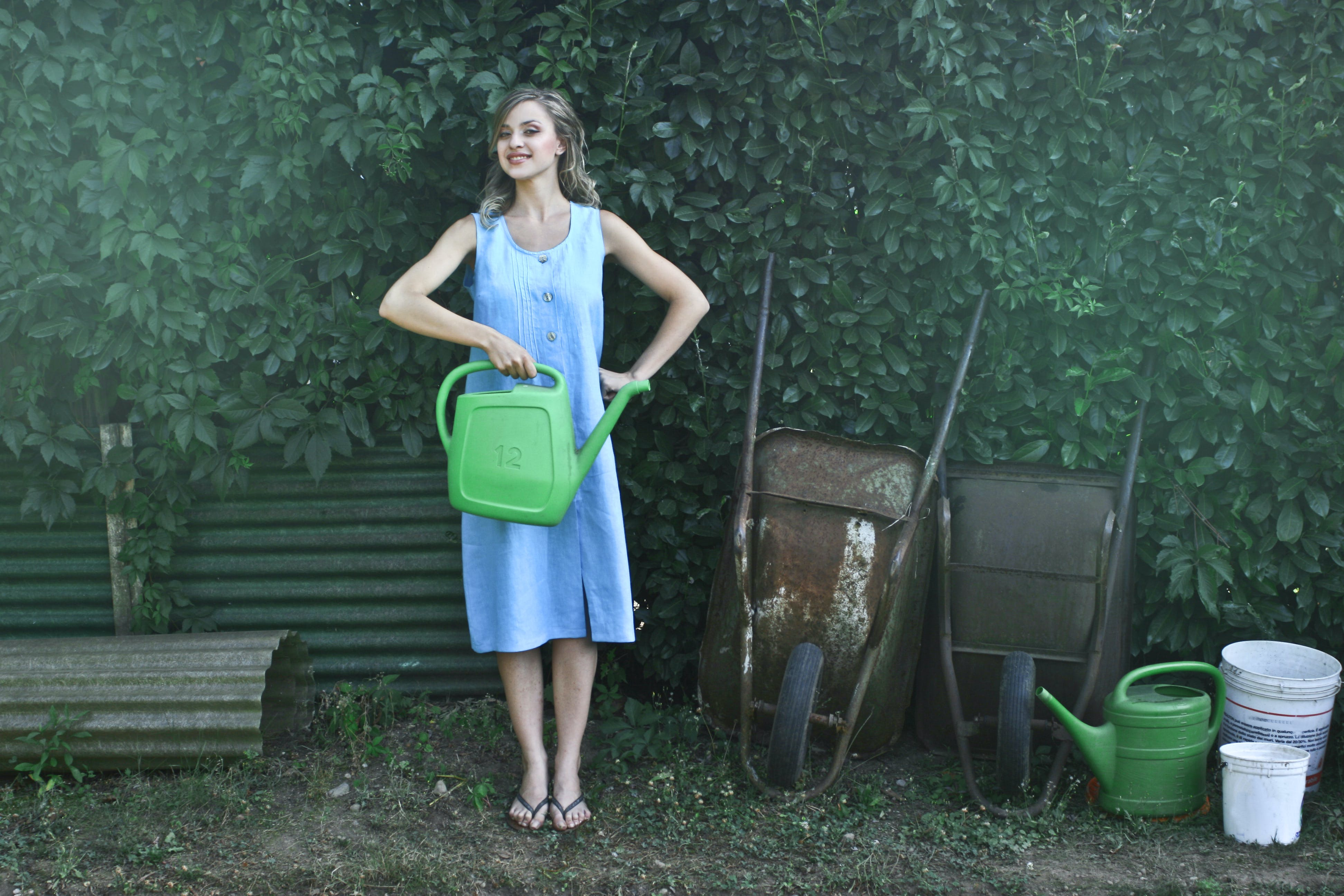 Photo of Woman Holding Watering Can