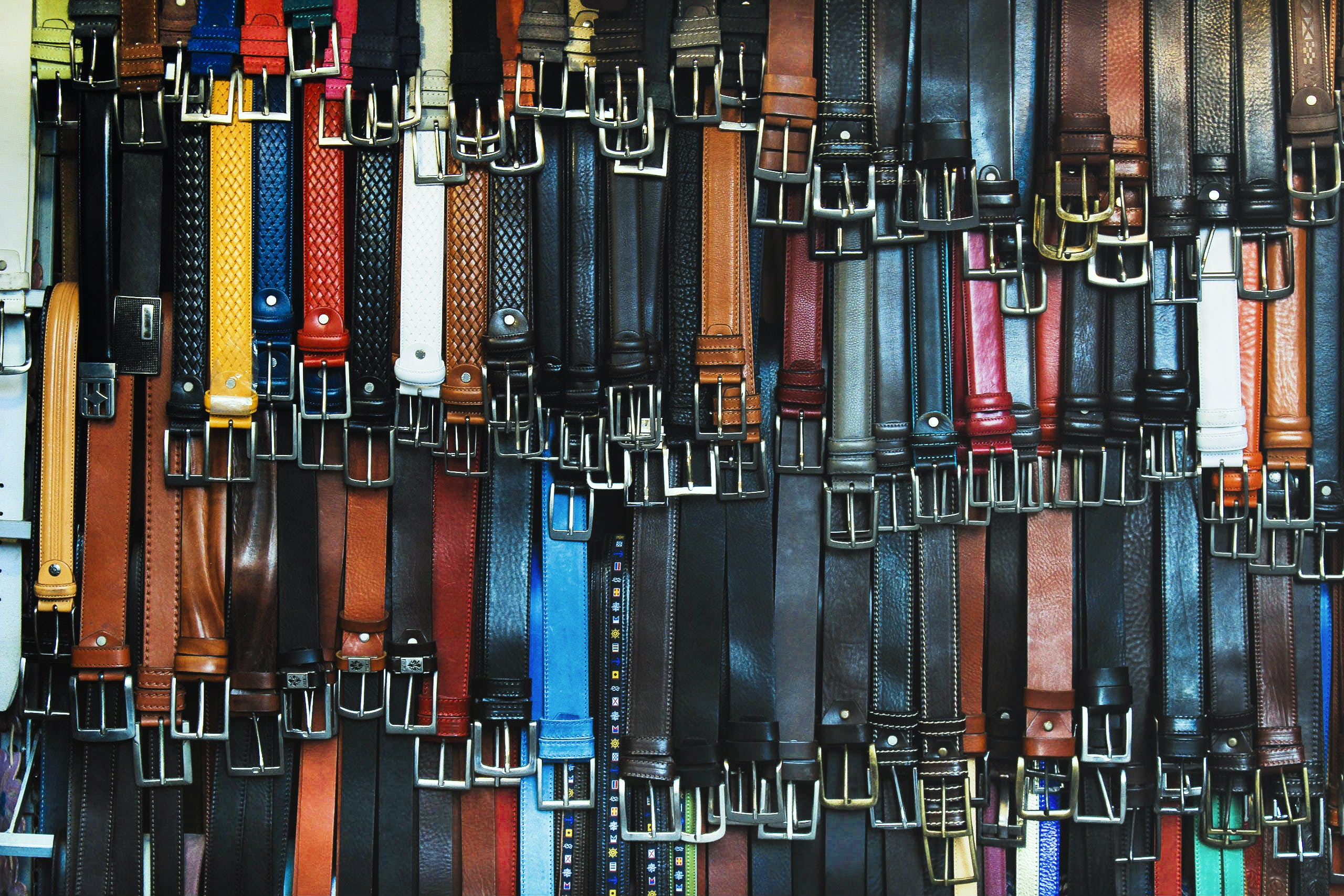 Shallow Focus Photography of Assorted-color Leather Belts