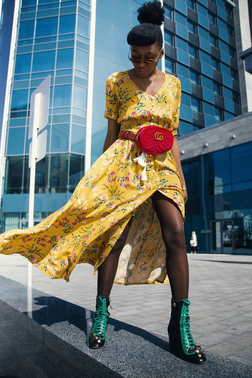 Woman Wearing Yellow Floral V-neck Long Dress and Pair of Green Wedge Sandals