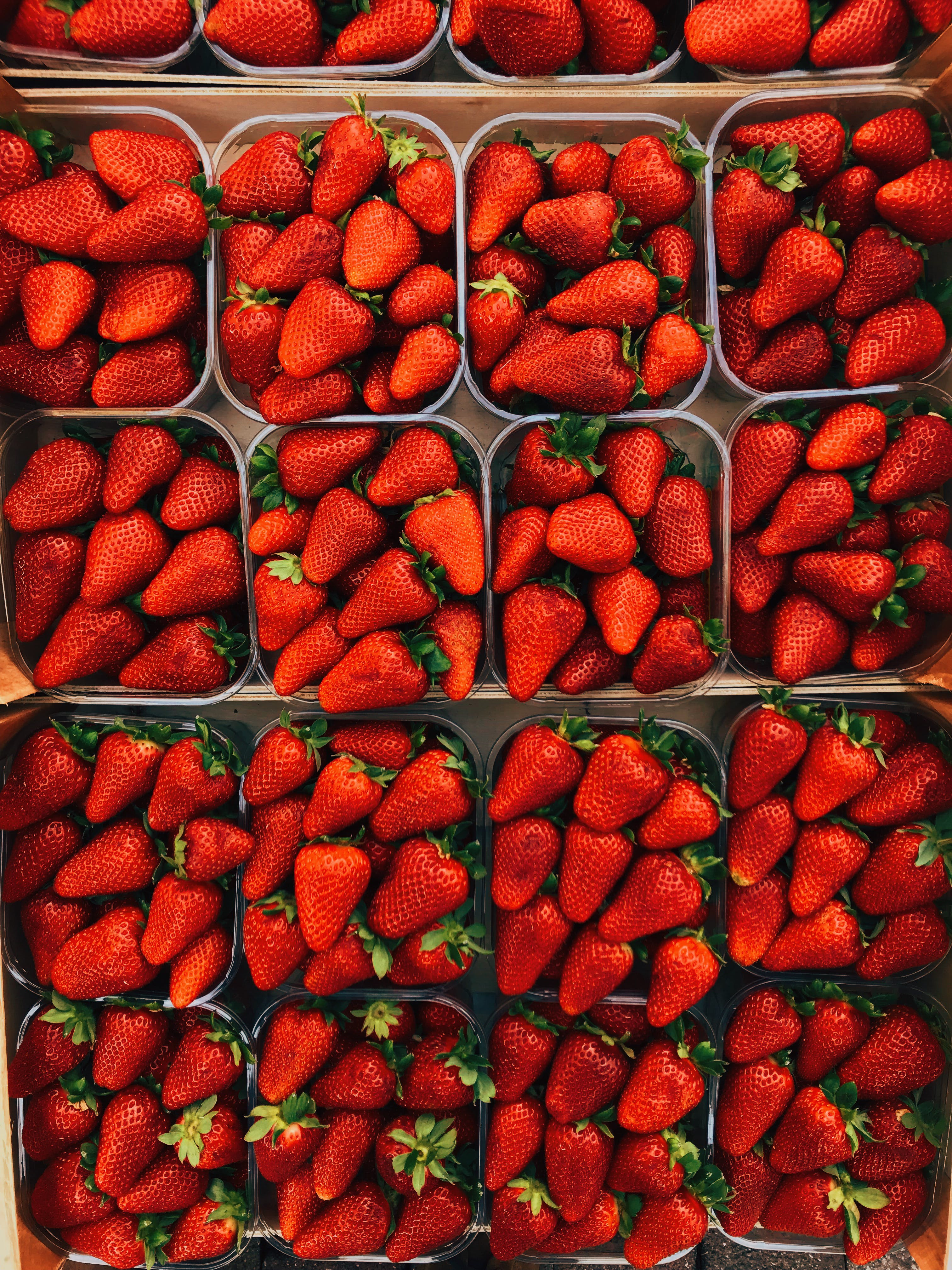 Top View Photography of Strawberries on Containers