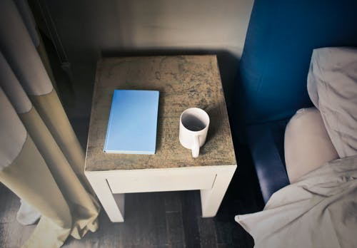 Photography of Side Table Near Bed