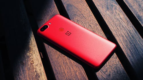 Close-Up Photography of Red Mobile Phone