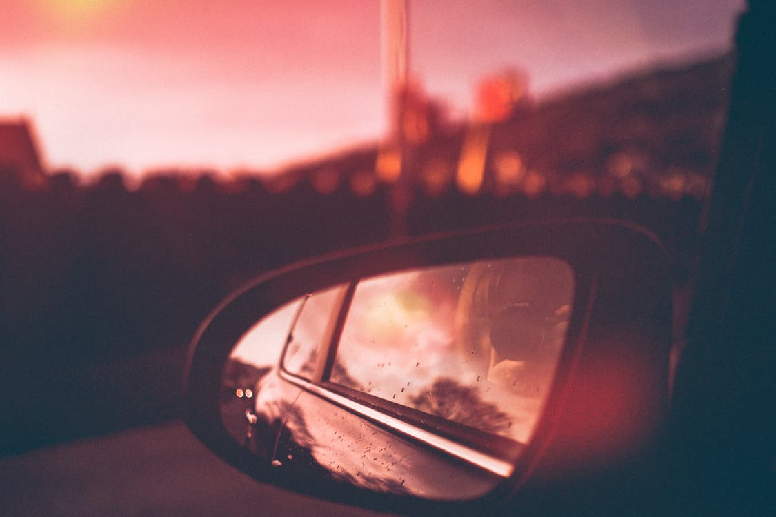 Close-Up Photography of Side Mirror During Dawn