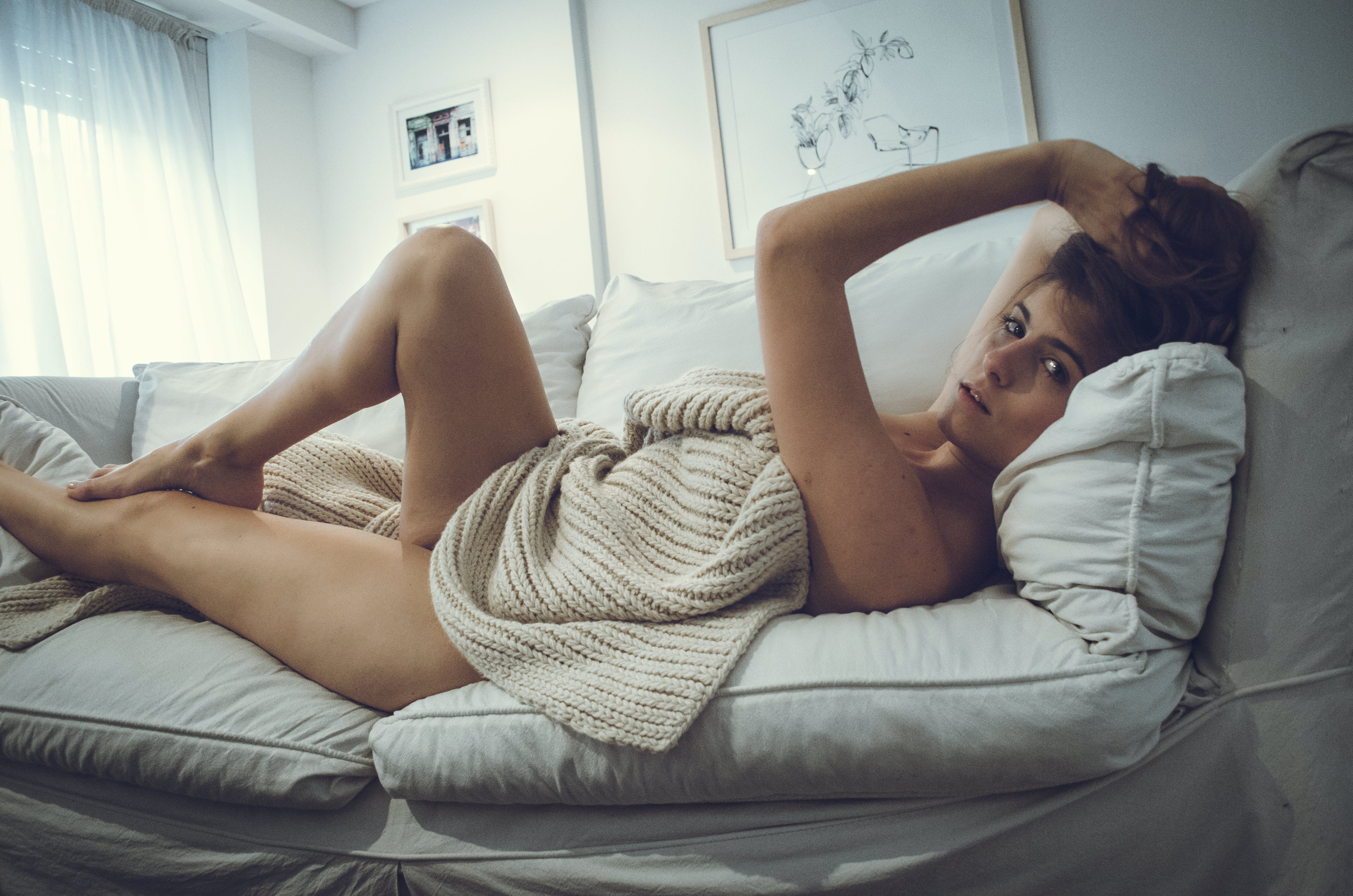 Photography of a Naked Woman Lying on Couch