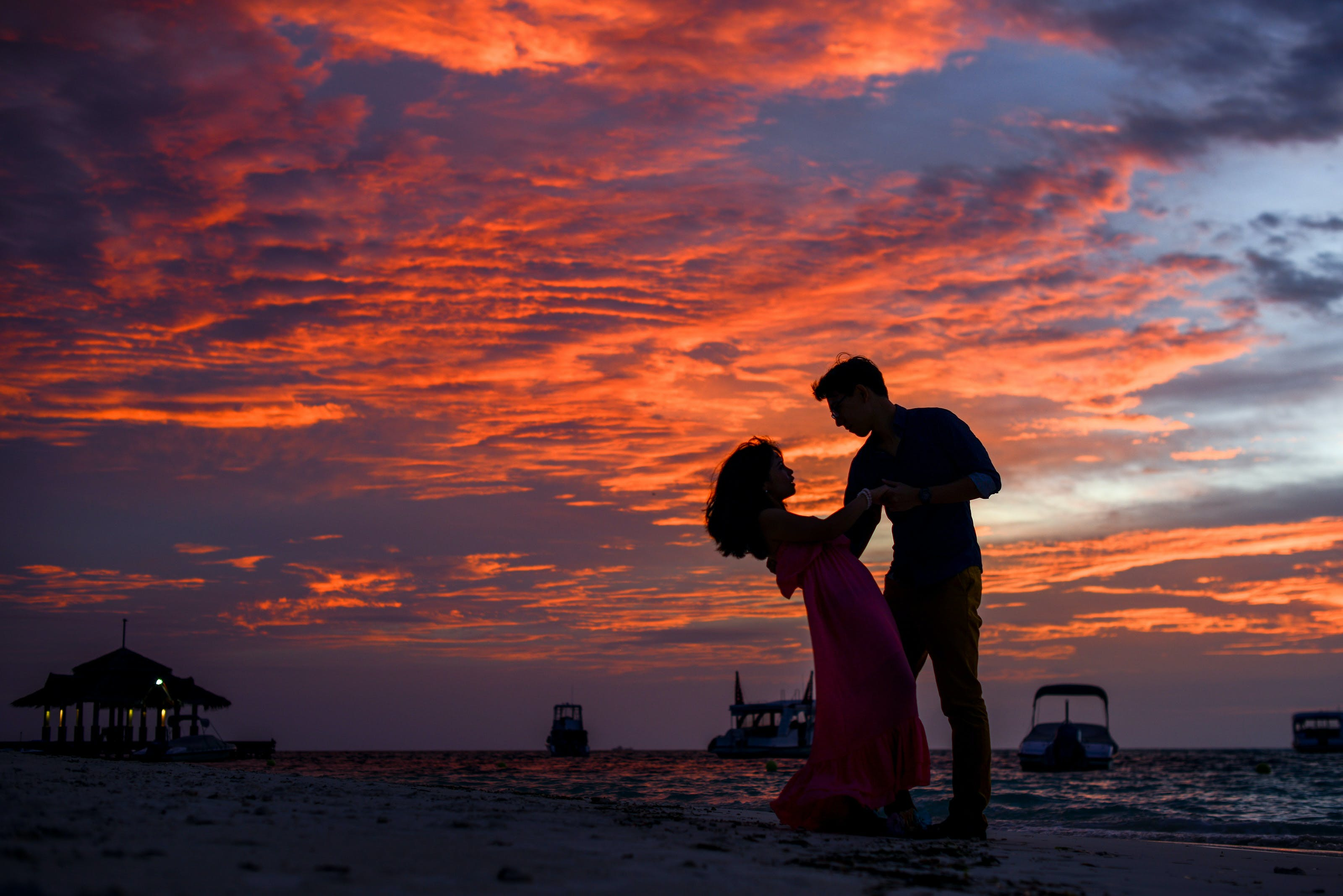 Man and Woman on Beach during Sunset