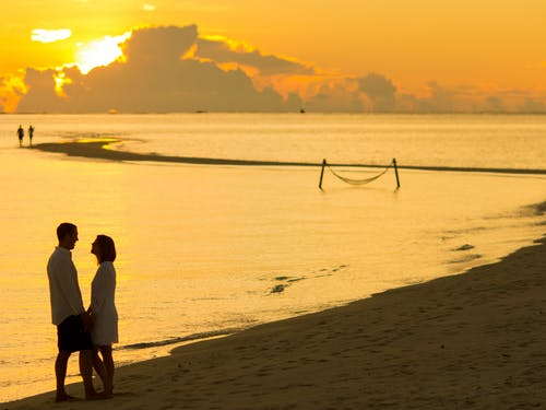 Man and Woman Facing Each Other in Front of Golden Hour