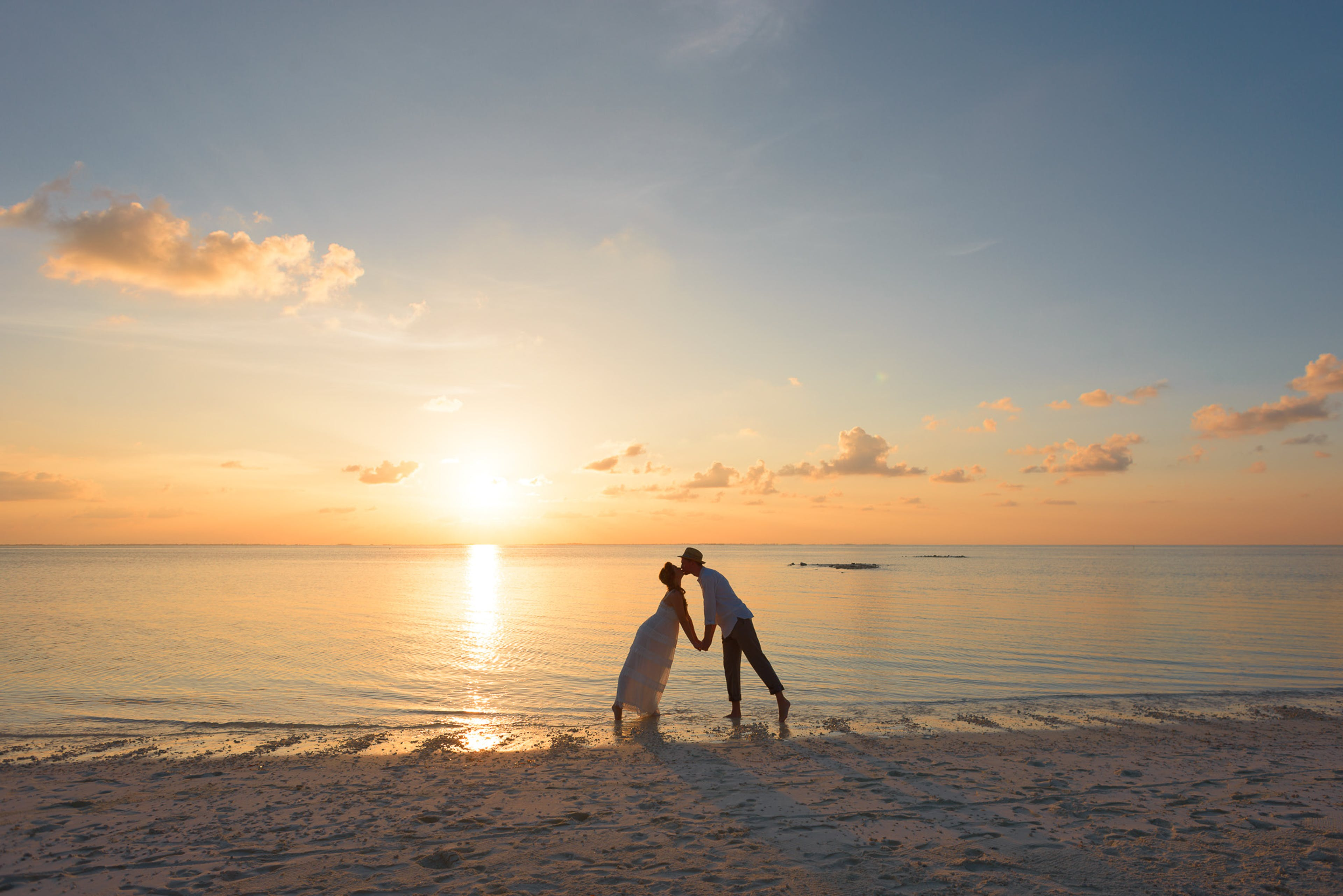 Man and Woman Standing on Shore Kissing