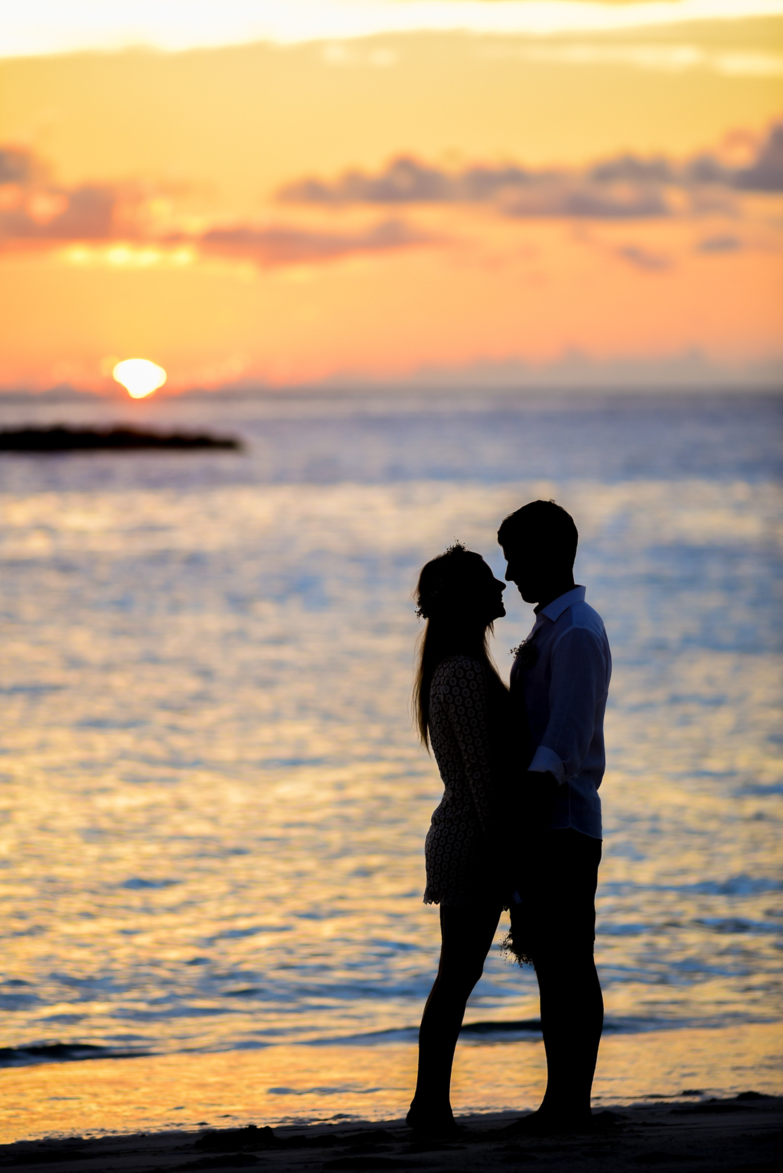 Silhouette of Couple on Seashore · Free Stock Photo