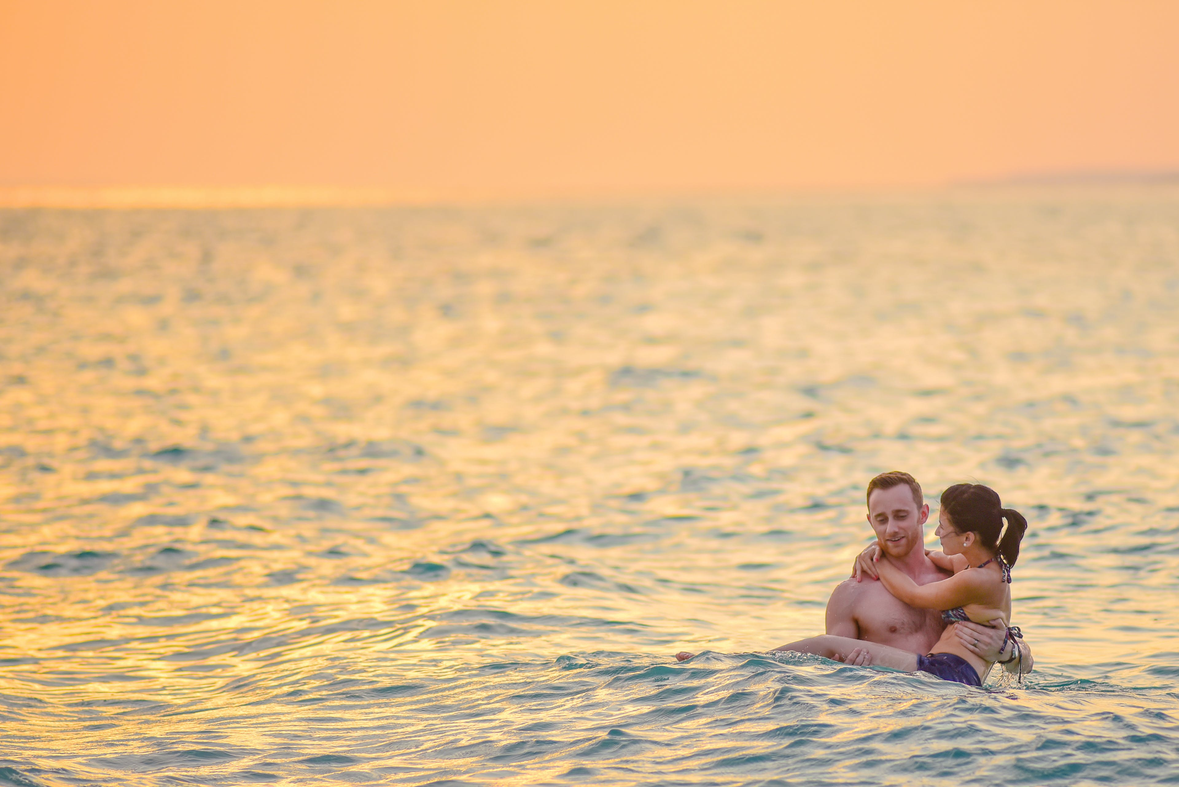 Man and Woman Swimming in a Beach