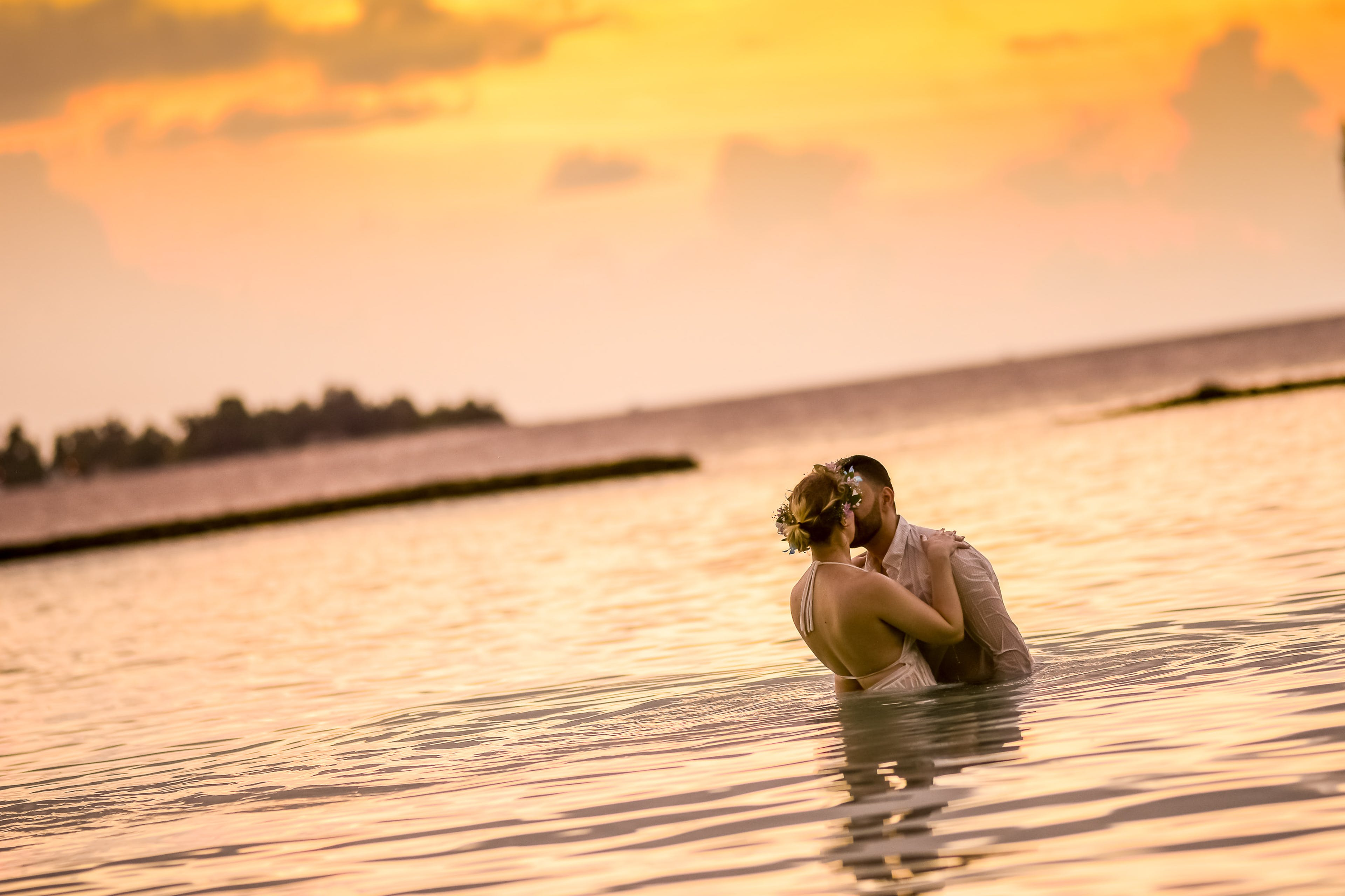 Woman and Man Kissing in Body of Water