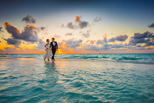 1000 interesting beach wedding photos pexels free stock photos man and woman walking of body of water junglespirit Images