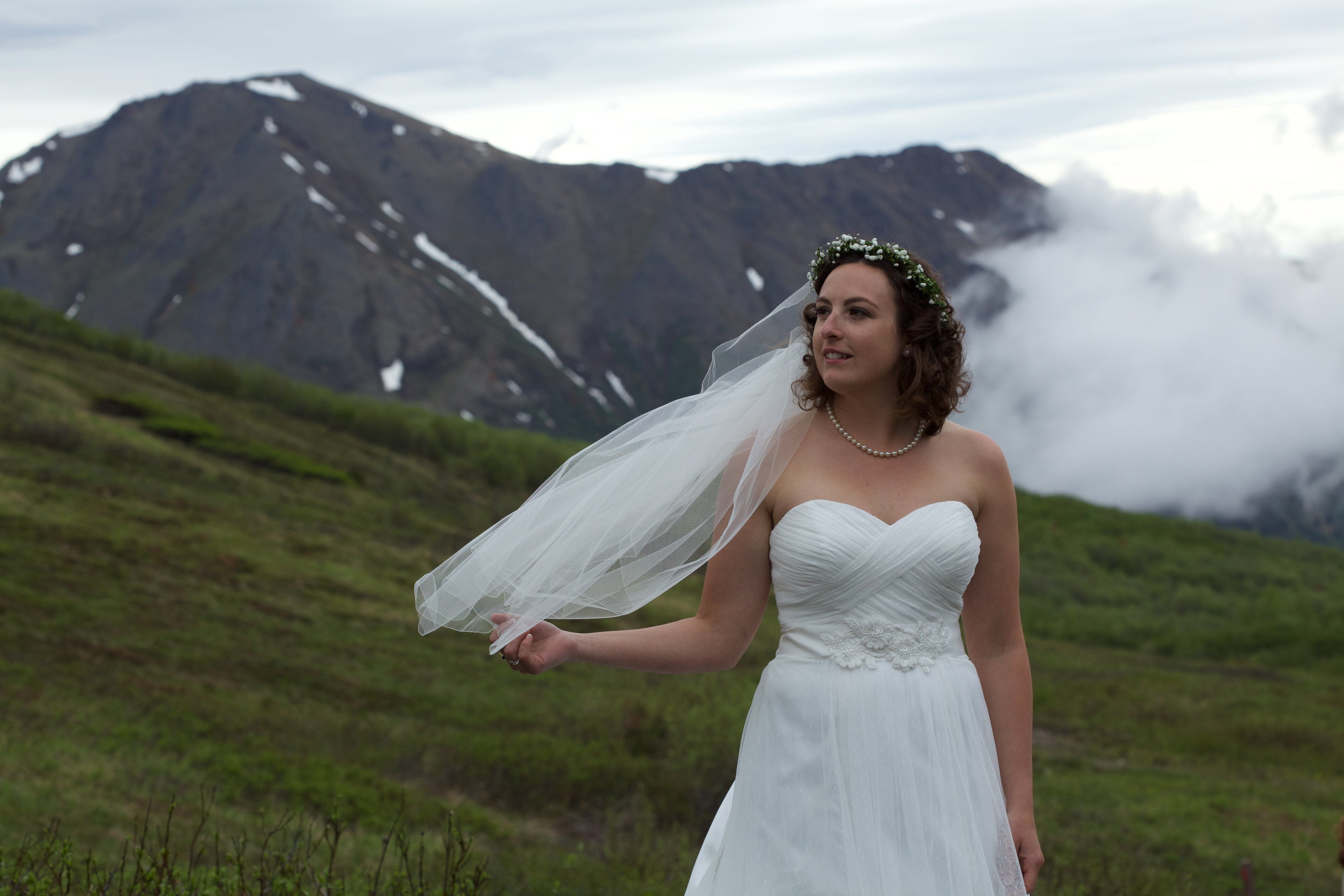 Woman Standing on Grass Wearing White Wedding Dress