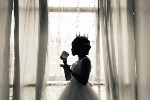 Woman in White Wedding Gown Holding Cup