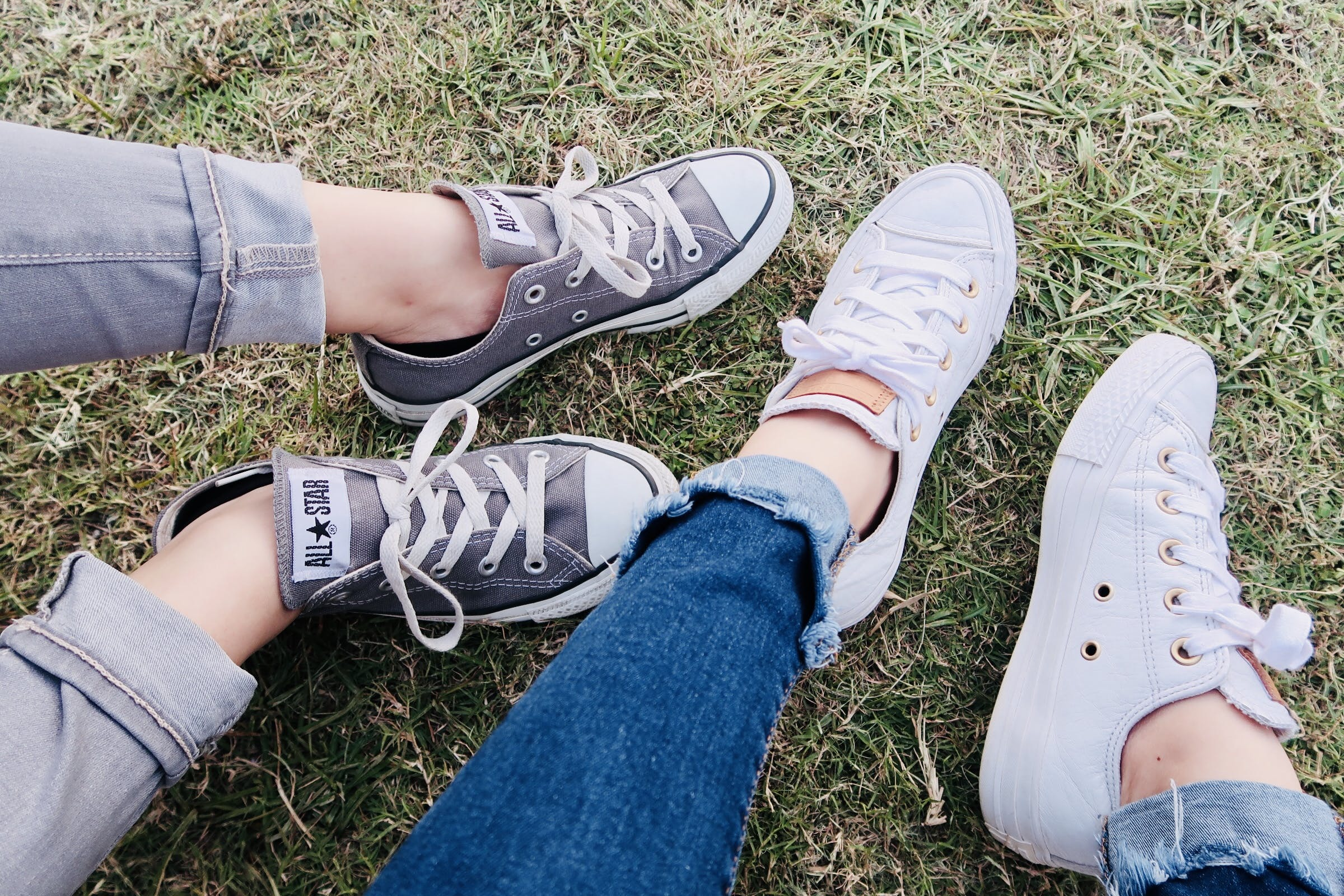 Two People Wearing Converse Allstar Low-top Sneakers