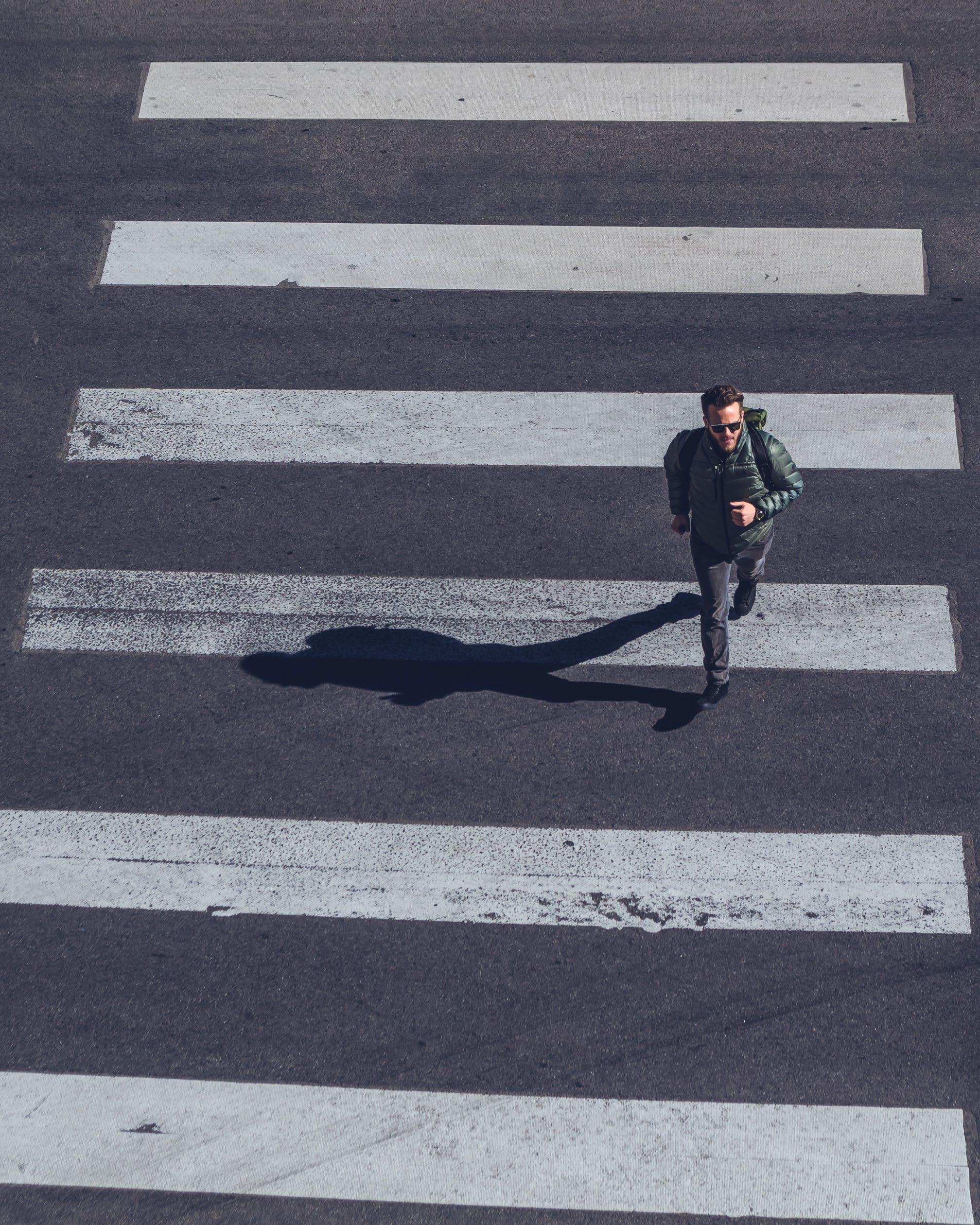 Man Crossing on Pedestrian Lane